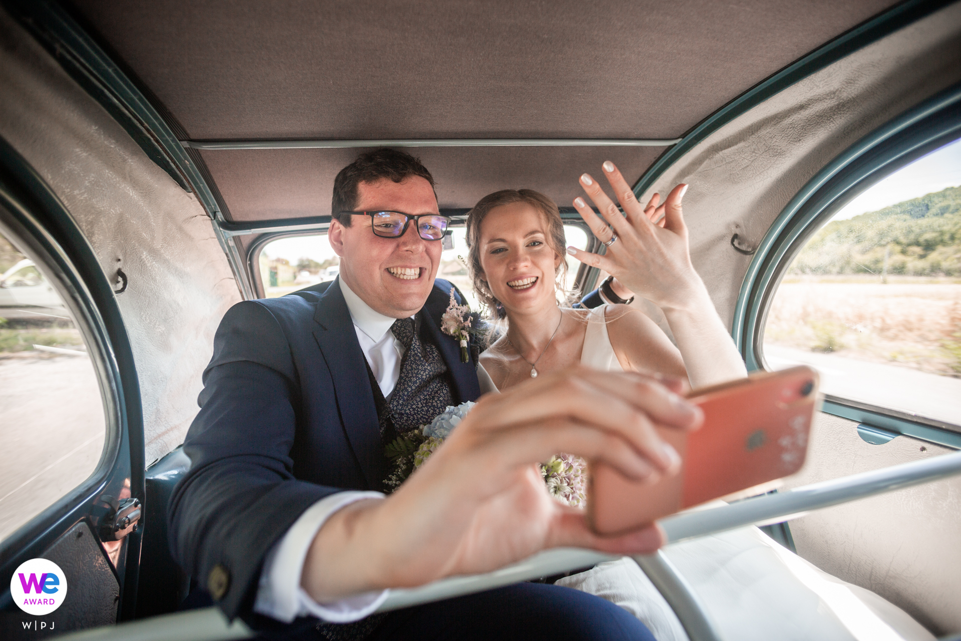 Albi France Elopement Photographer | Cuddled up in the car together after their ceremony, the couple video chats with family