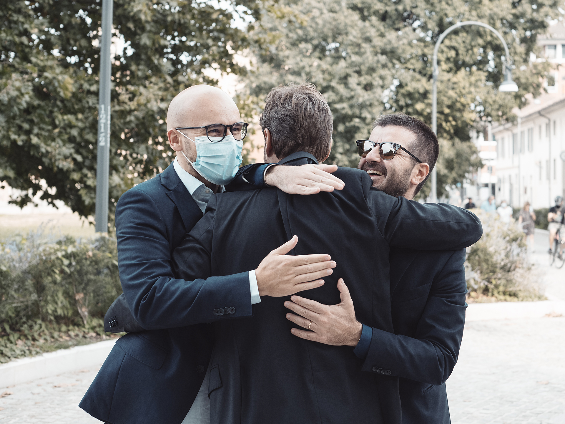 Italian Villa elopement reception image | two of the groom's close friends congratulate him