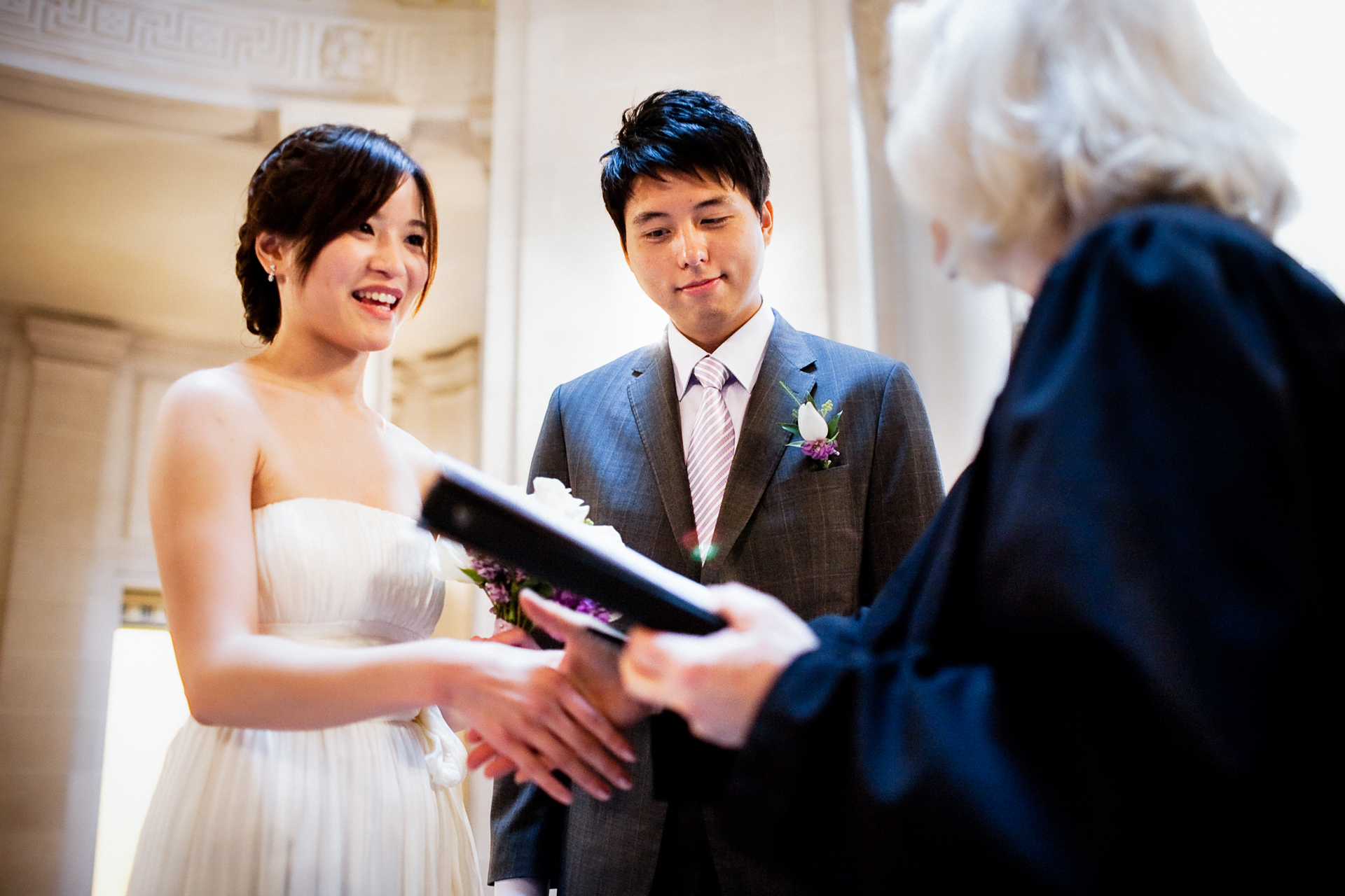 Elopement Photographers for San Francisco City Hall | A handshake with the officiant