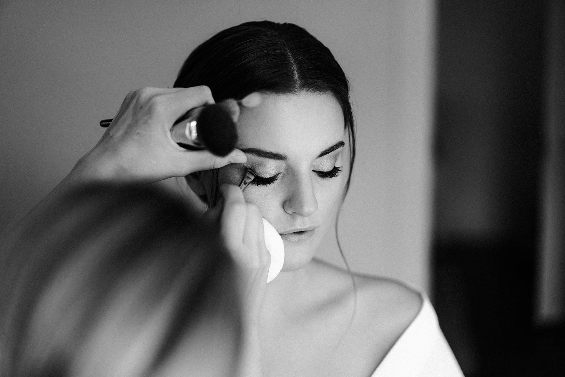 Zurich Wedding Photographer | The bride has makeup applied during her preparations