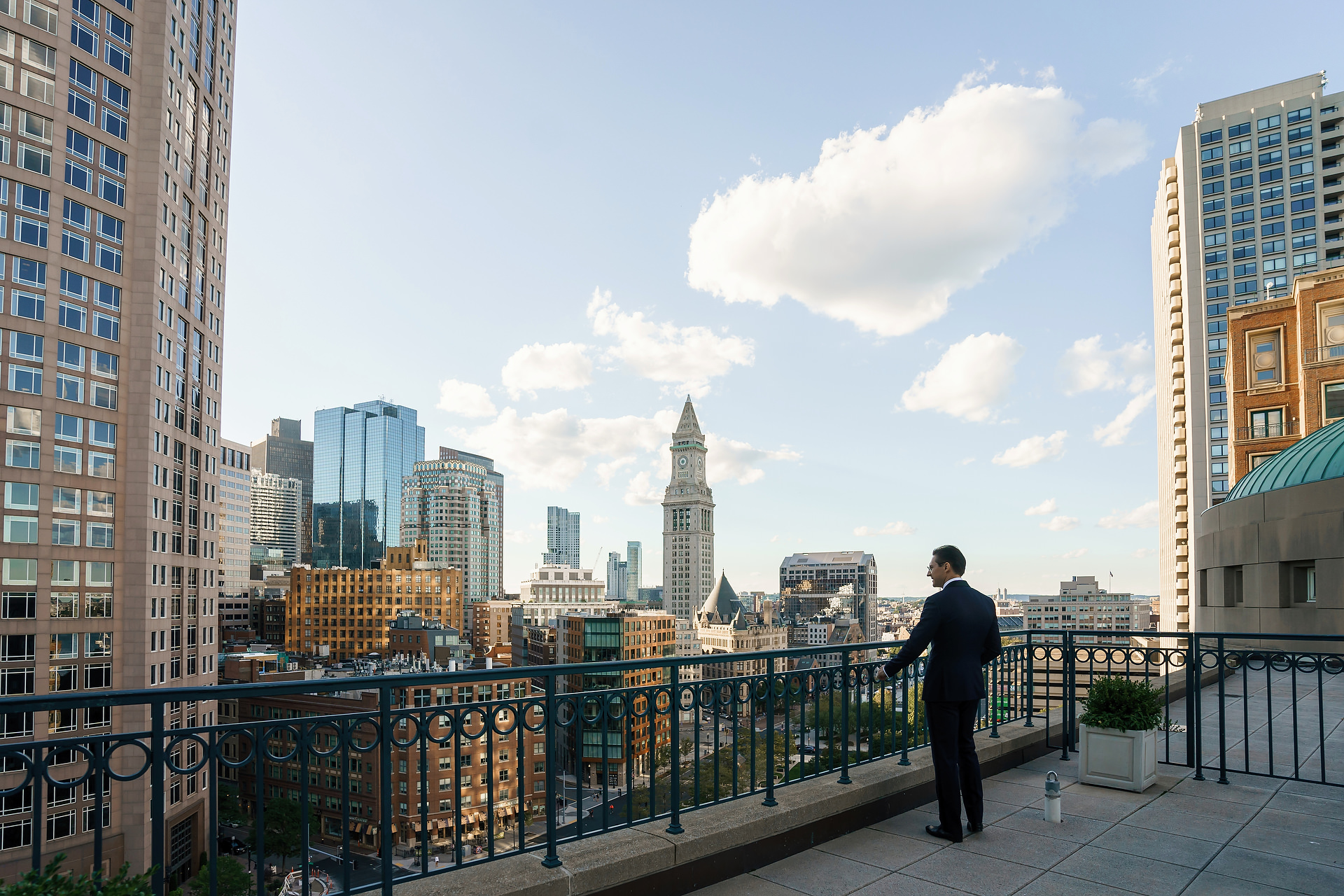 Boston Harbor Hotel Wedding Images | The groom waits for his bride on the balcony