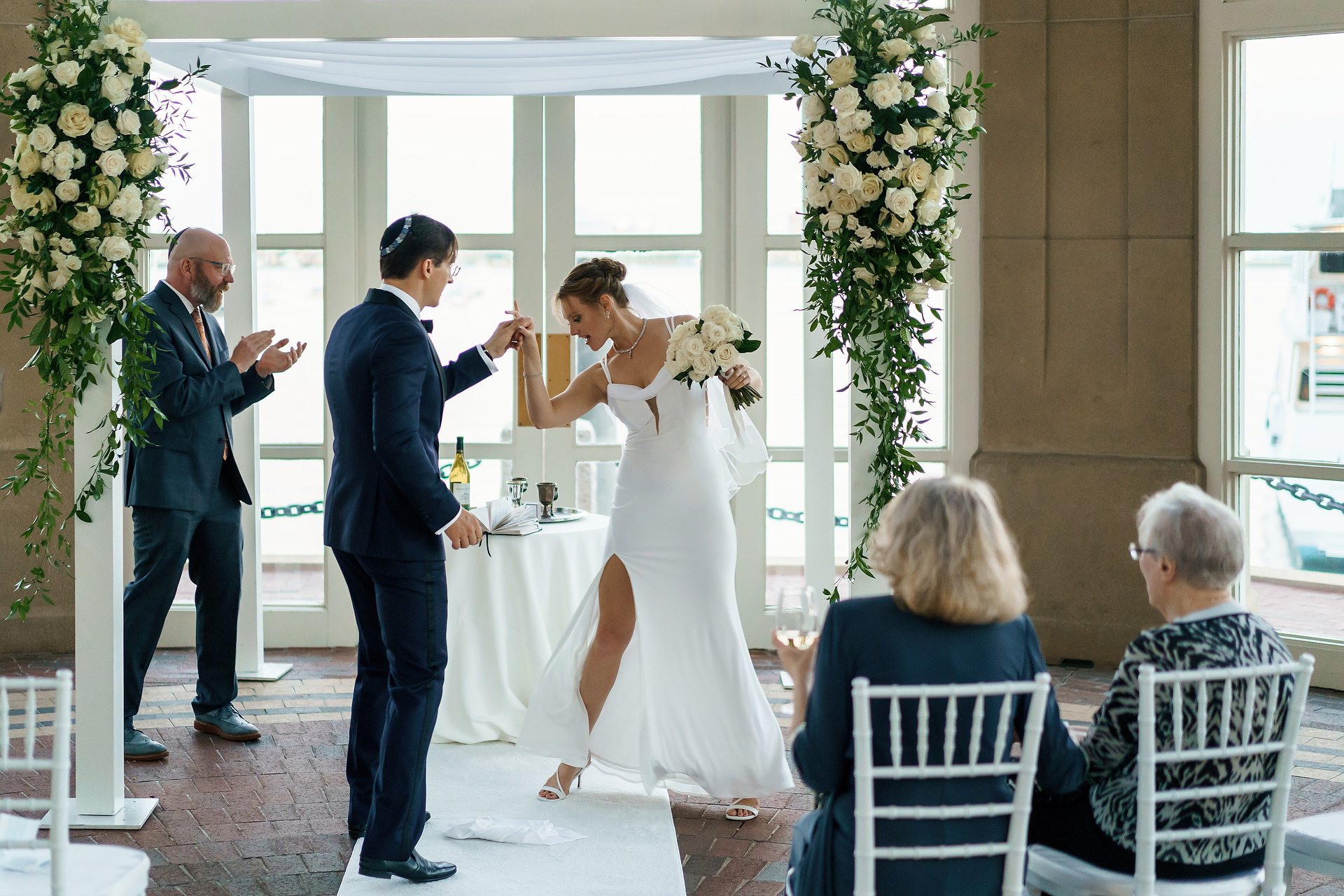 Boston Harbor Hotel Wedding Photos | The couple concludes the ceremony with a Jewish tradition