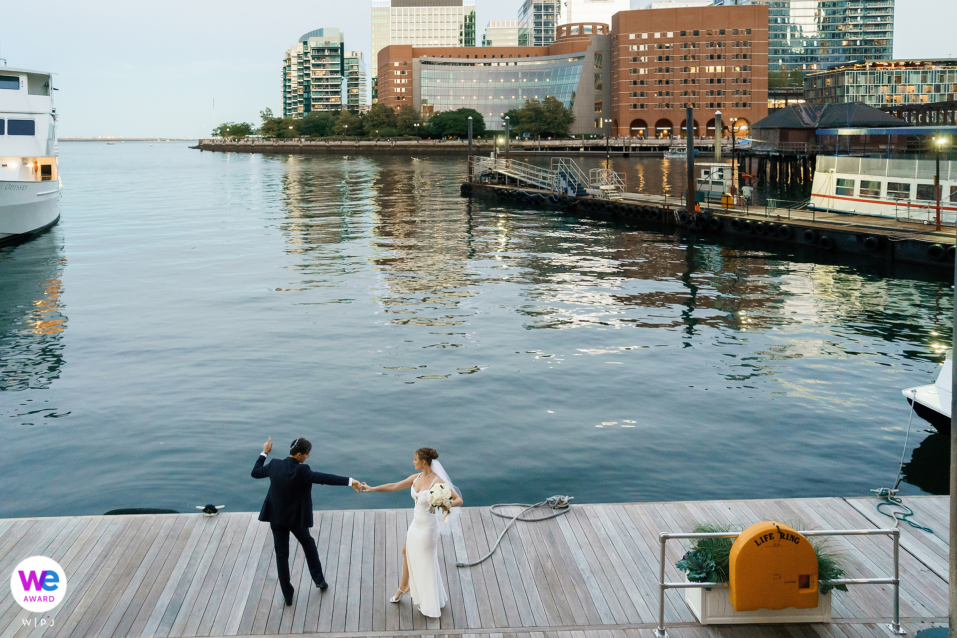 Boston Harbor Hotel Wedding Photography | Dancing together on the docks of the Harbor