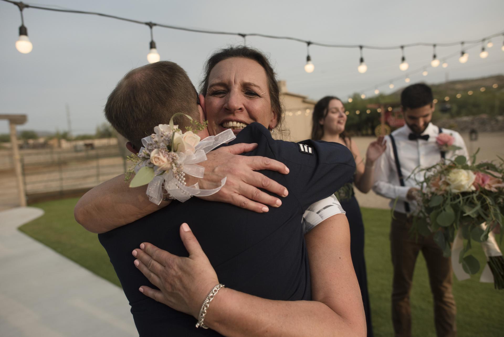 AZ Wedding Photographer | The bride's mother hugs the groom