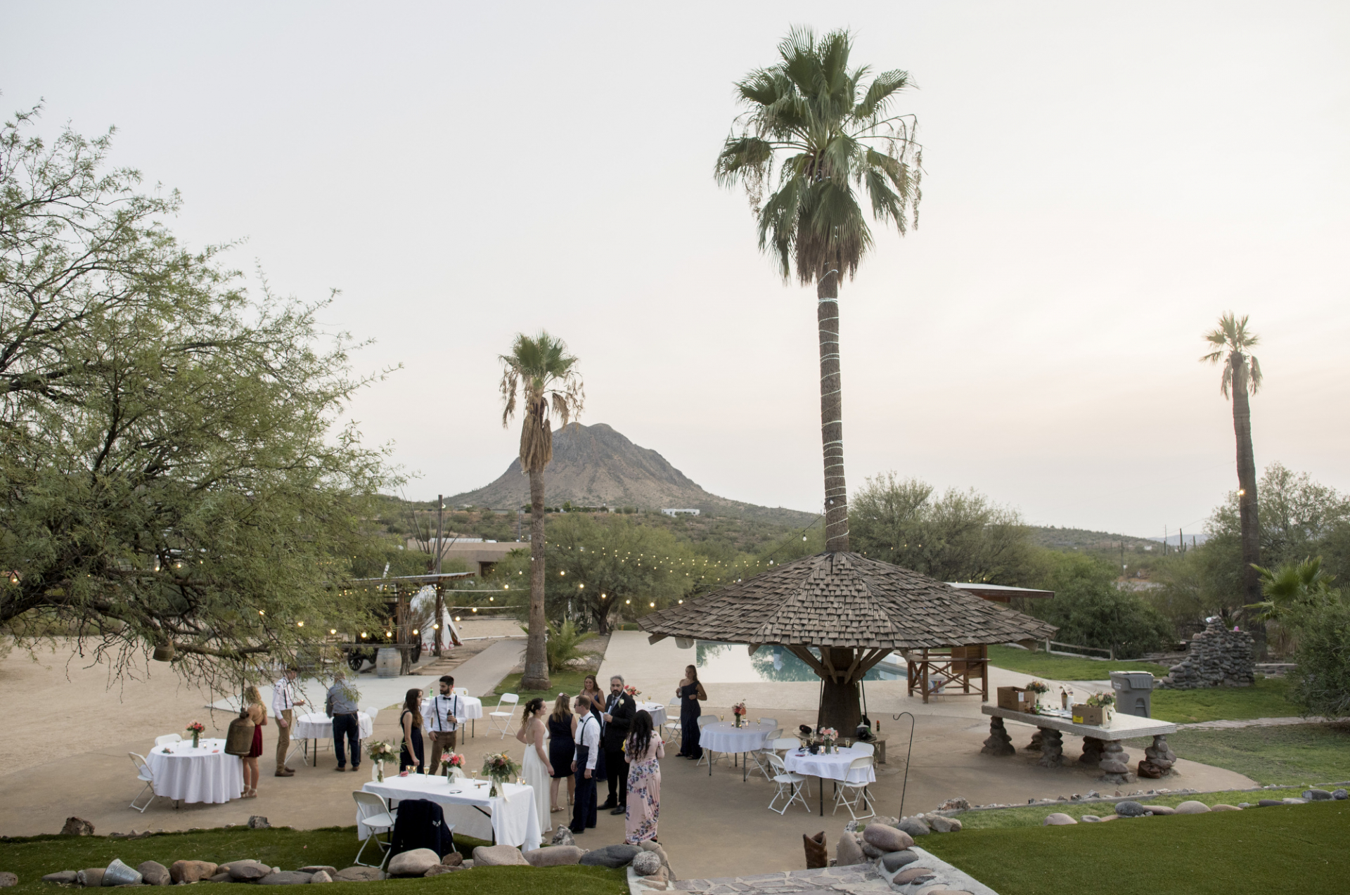 AZ Rental Home Wedding Photos | The guests mingle with the happy couple