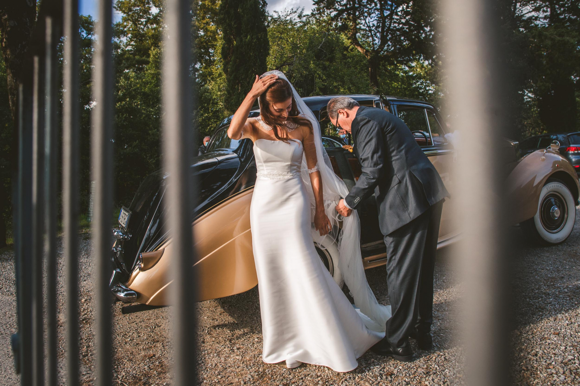 San Galgano Elopement Photographers - Italy   The bride's father helps her with her long veil