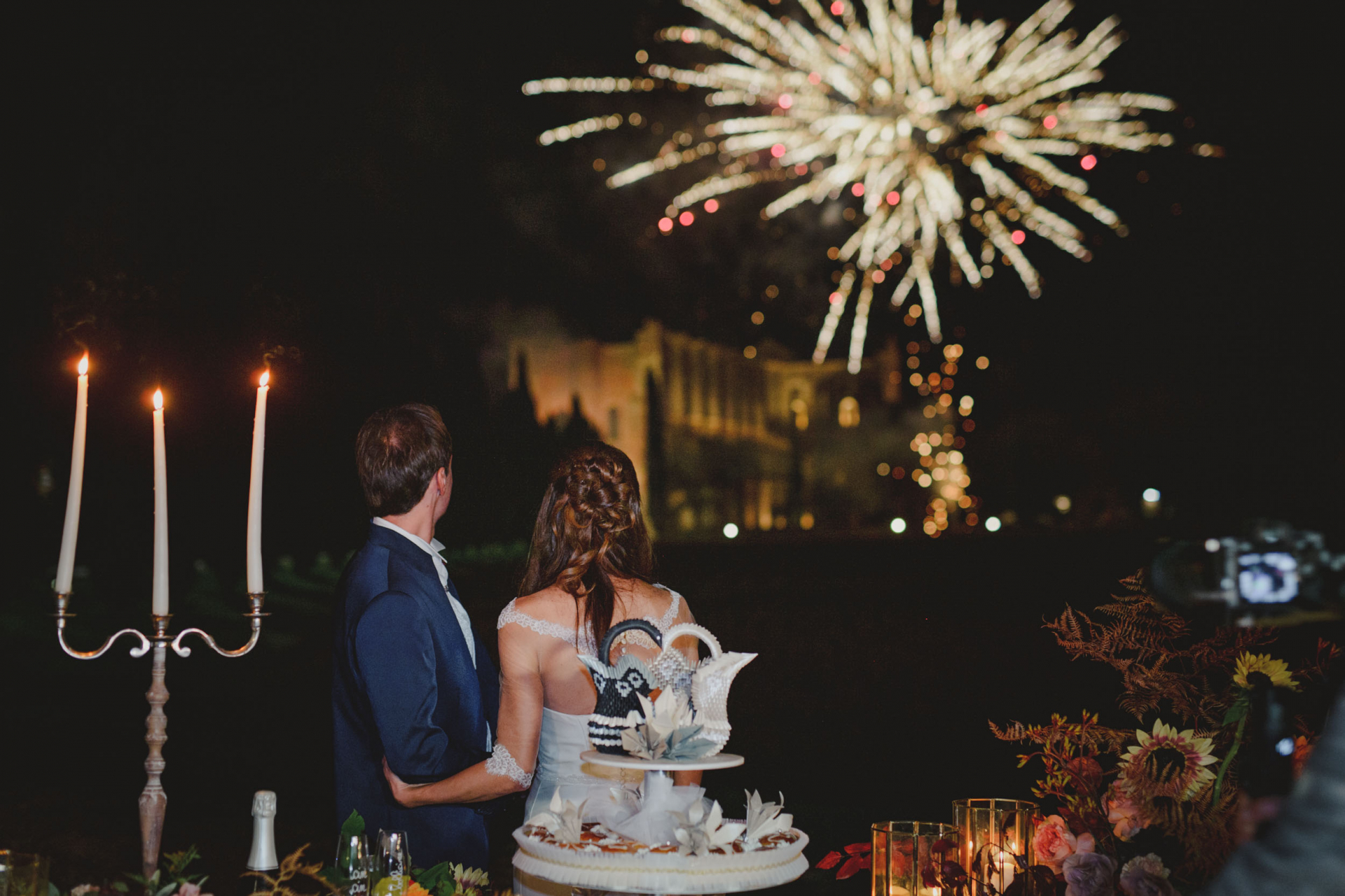 Agriturismo San Galgano Elopement Photography   The couple, after cutting their cake and enjoying their outdoor reception by candlelight