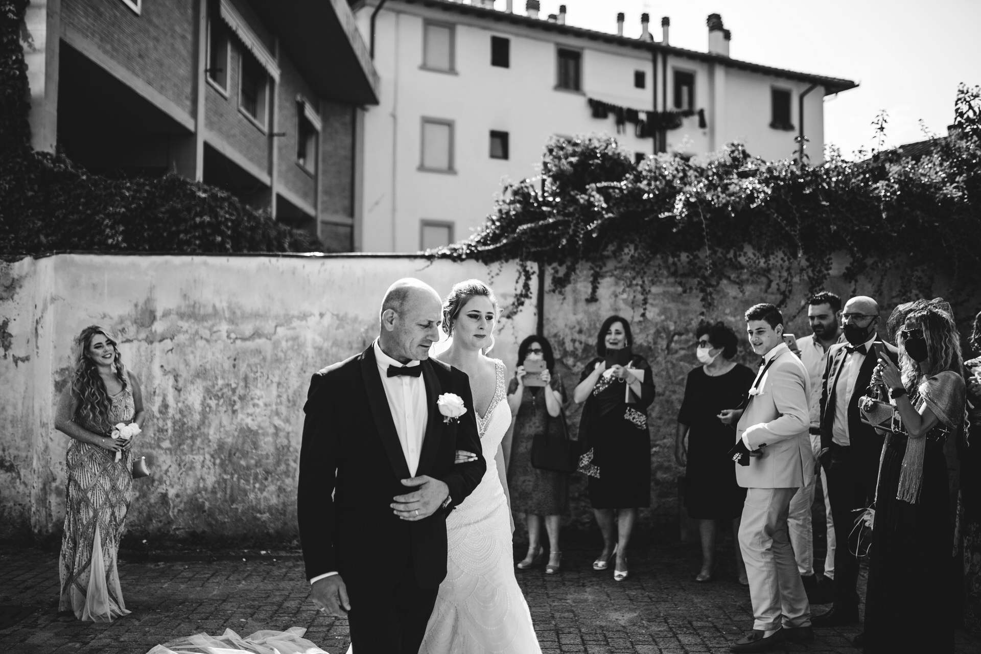 Wedding Image from the Town Hall of Borgo San Lorenzo, Florence | The bride is guided through cobblestone streets
