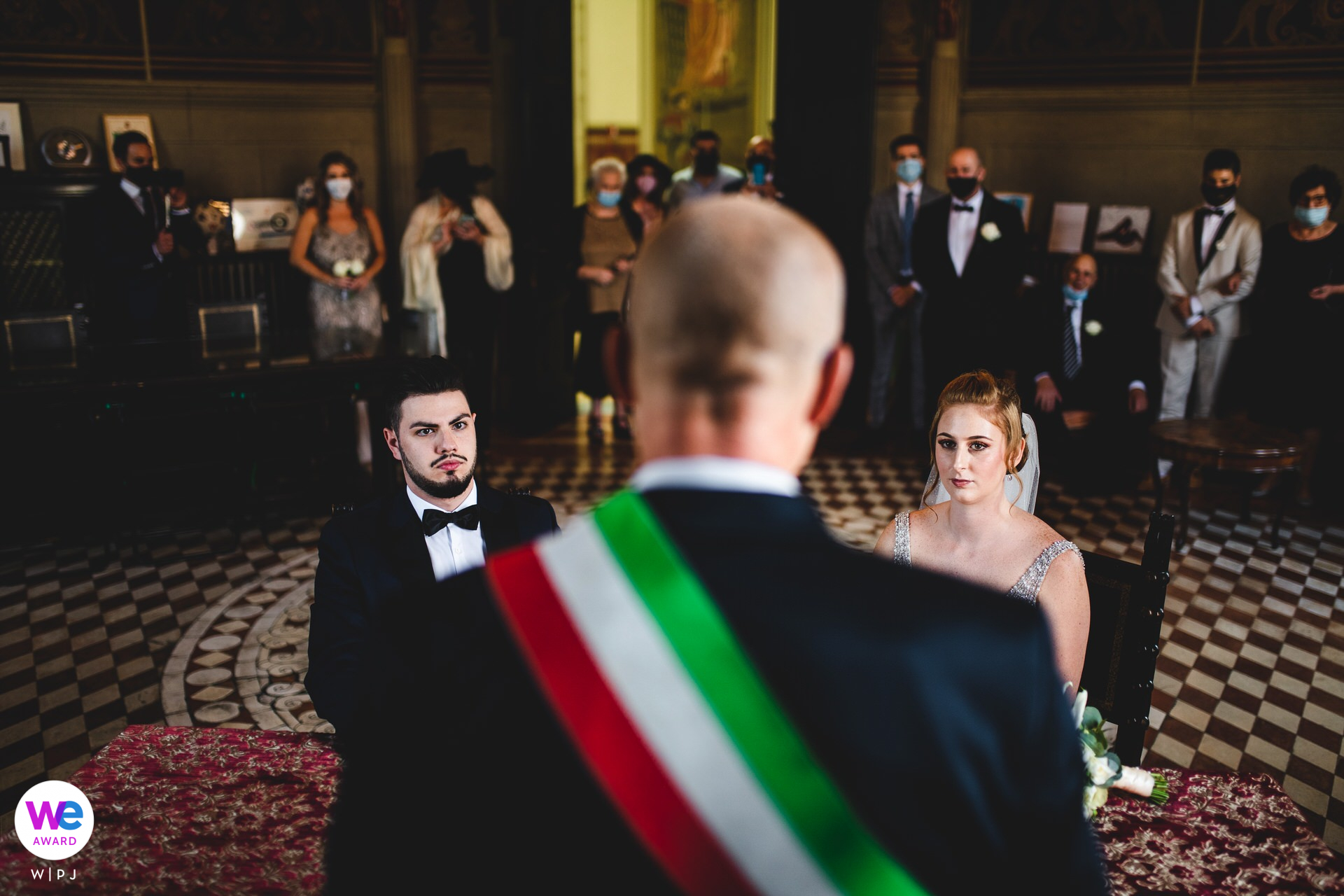 Florence Intimate Wedding Photo - Town Hall of Borgo San Lorenzo | Here we see the couple seated in the town hall