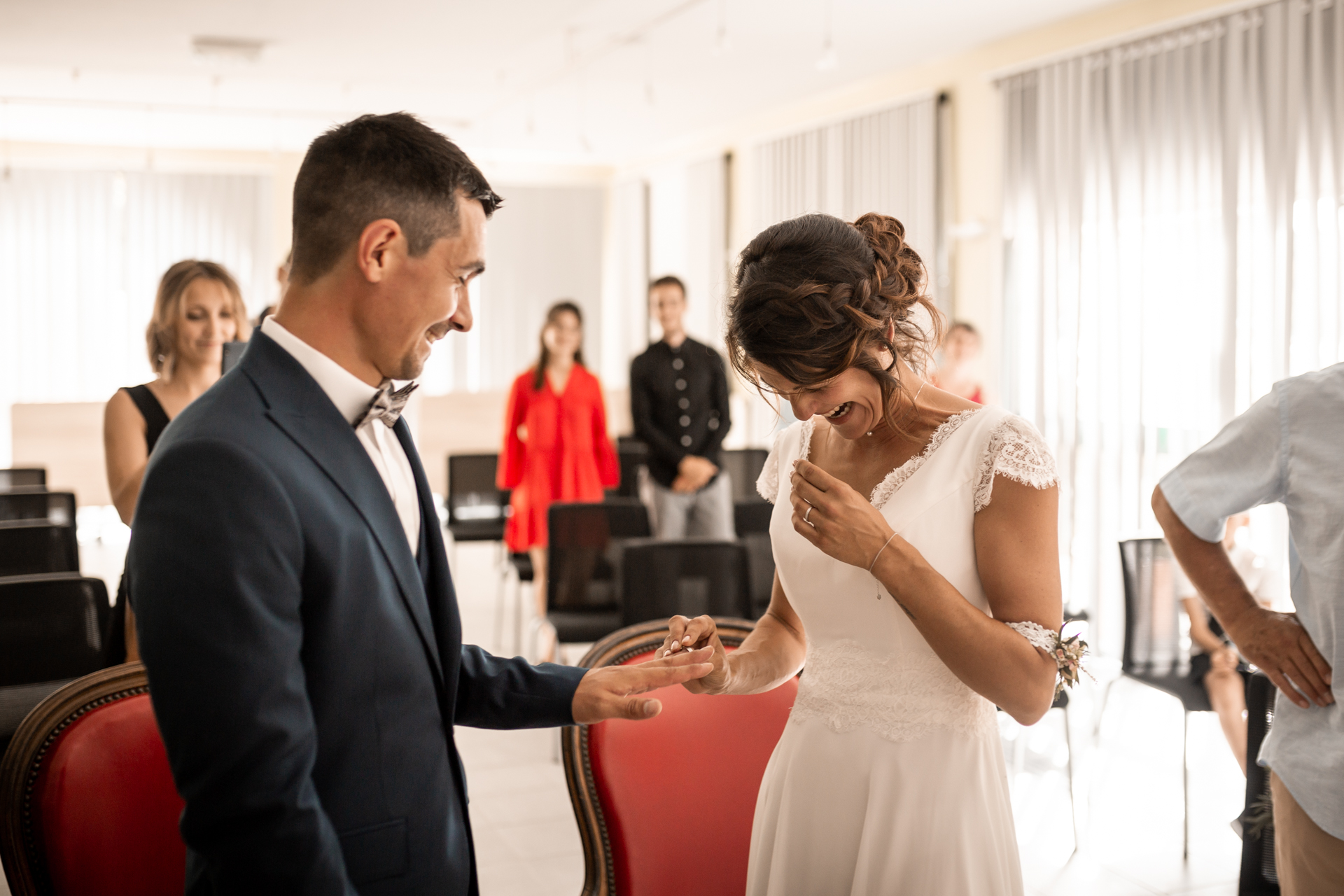 Town Hall Lescure, Tarn, France Wedding Image | The bride was really nervous at the ring moment that she started to give him the wrong hand