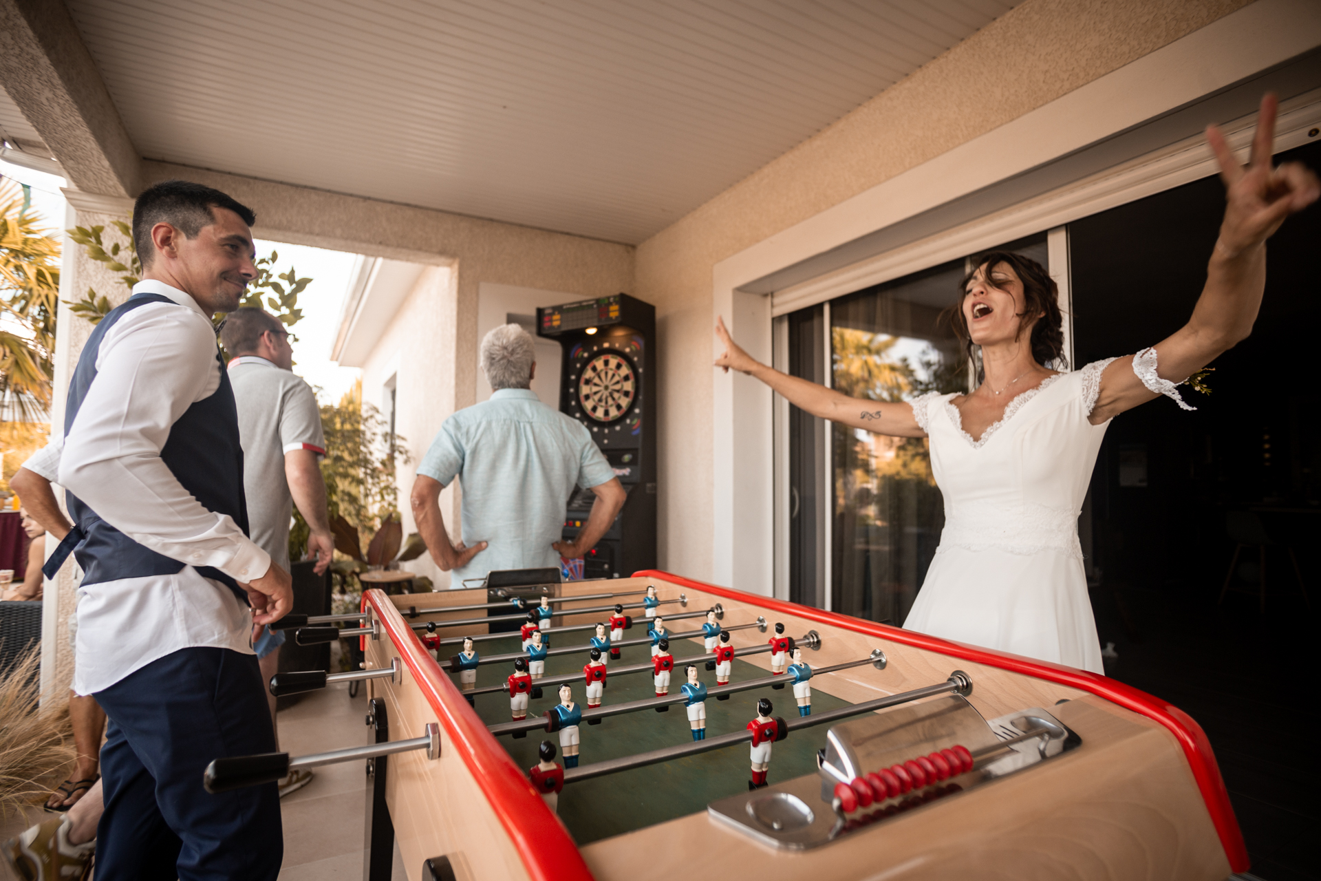 Wedding Photographers for France | During the cocktail hour they decided to play foosball