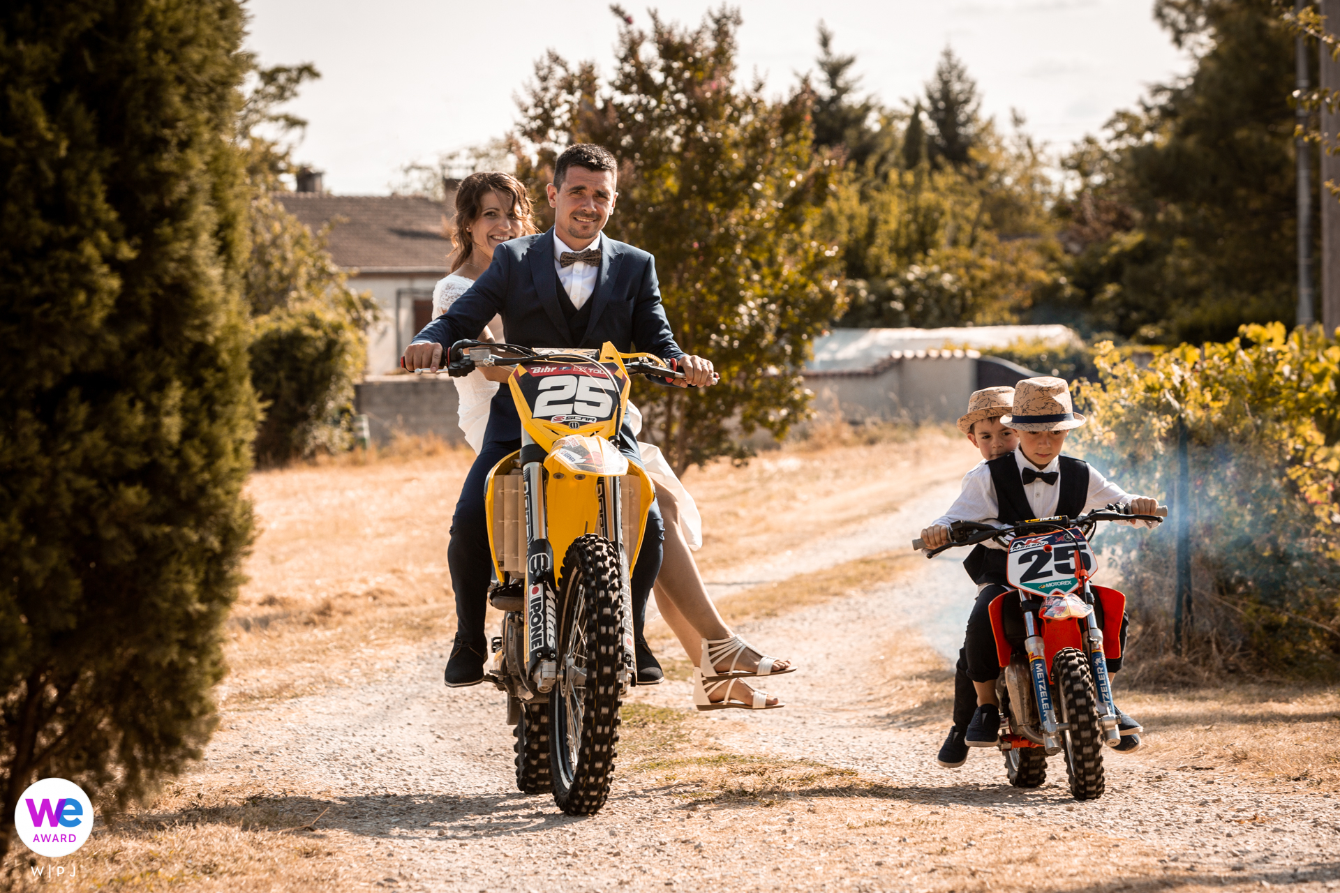 Lescure, Tarn, France Wedding Photography | The couple could make it to the ceremony by motorbikes through a small path with their sons