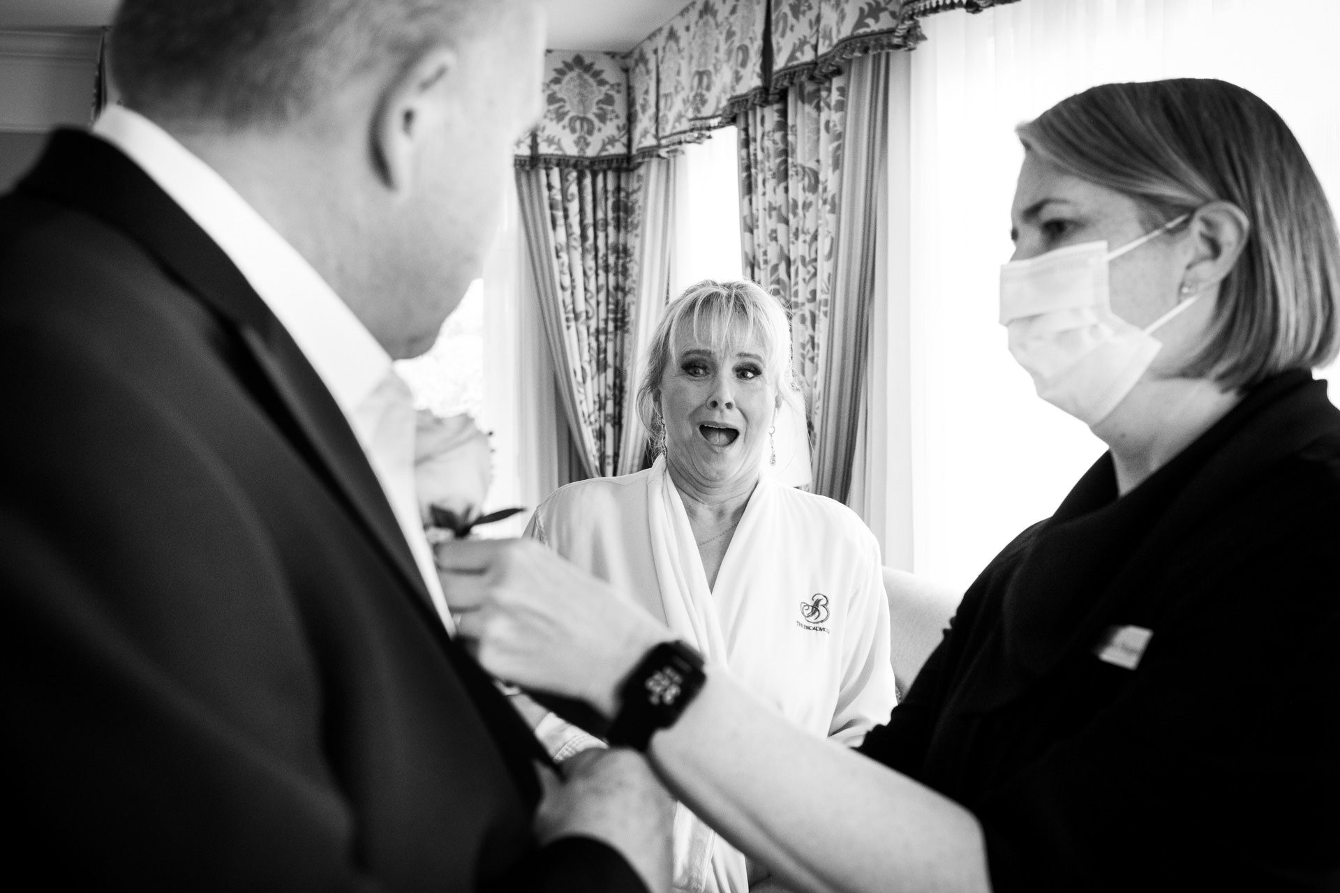 Wedding Photographer at the Broadmoor Hotel and Resort | The bride reacts to seeing the grooms boutonniere