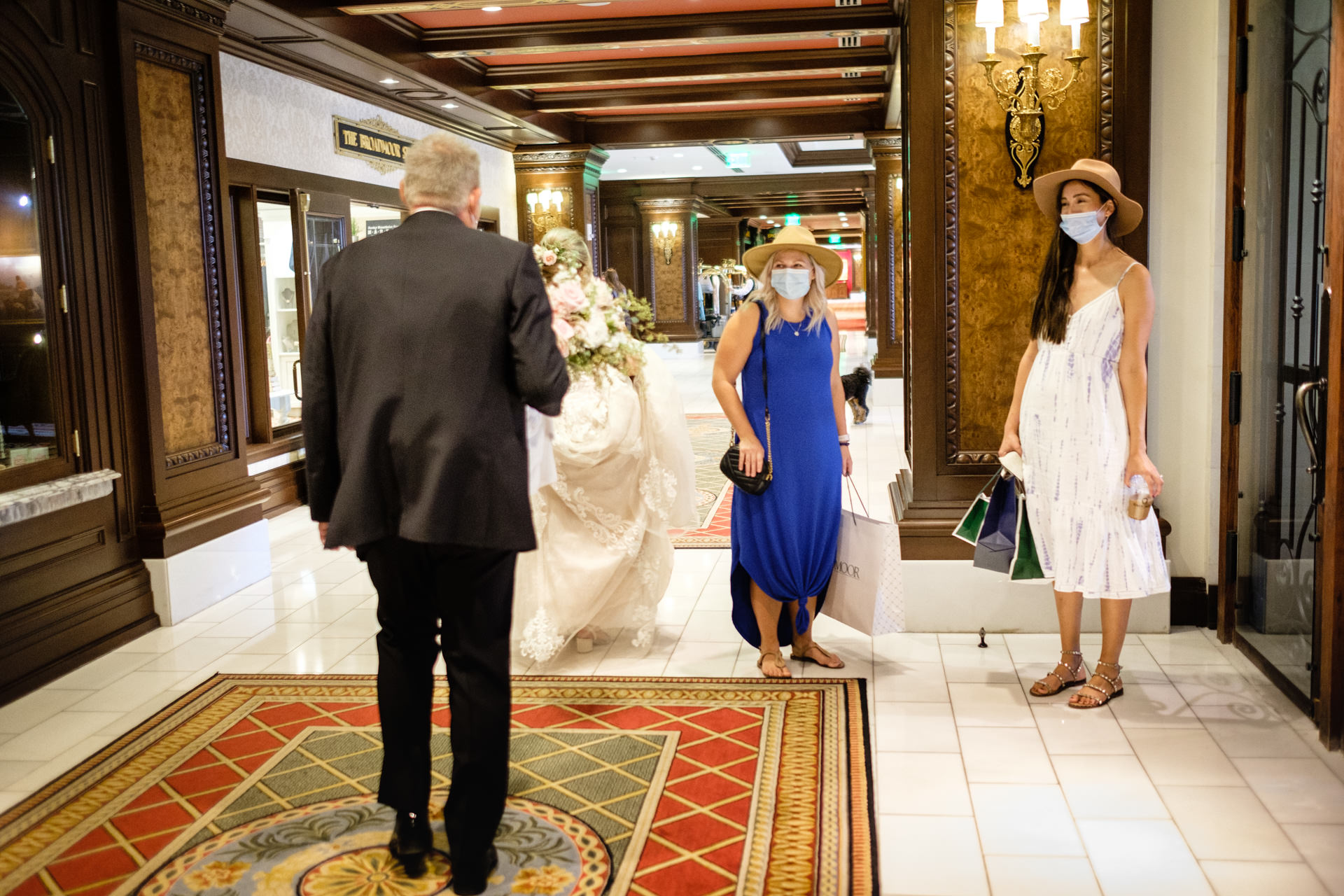 Colorado Springs Broadmoor Hotel Wedding Picture | on their way to their wedding ceremony through the lobby