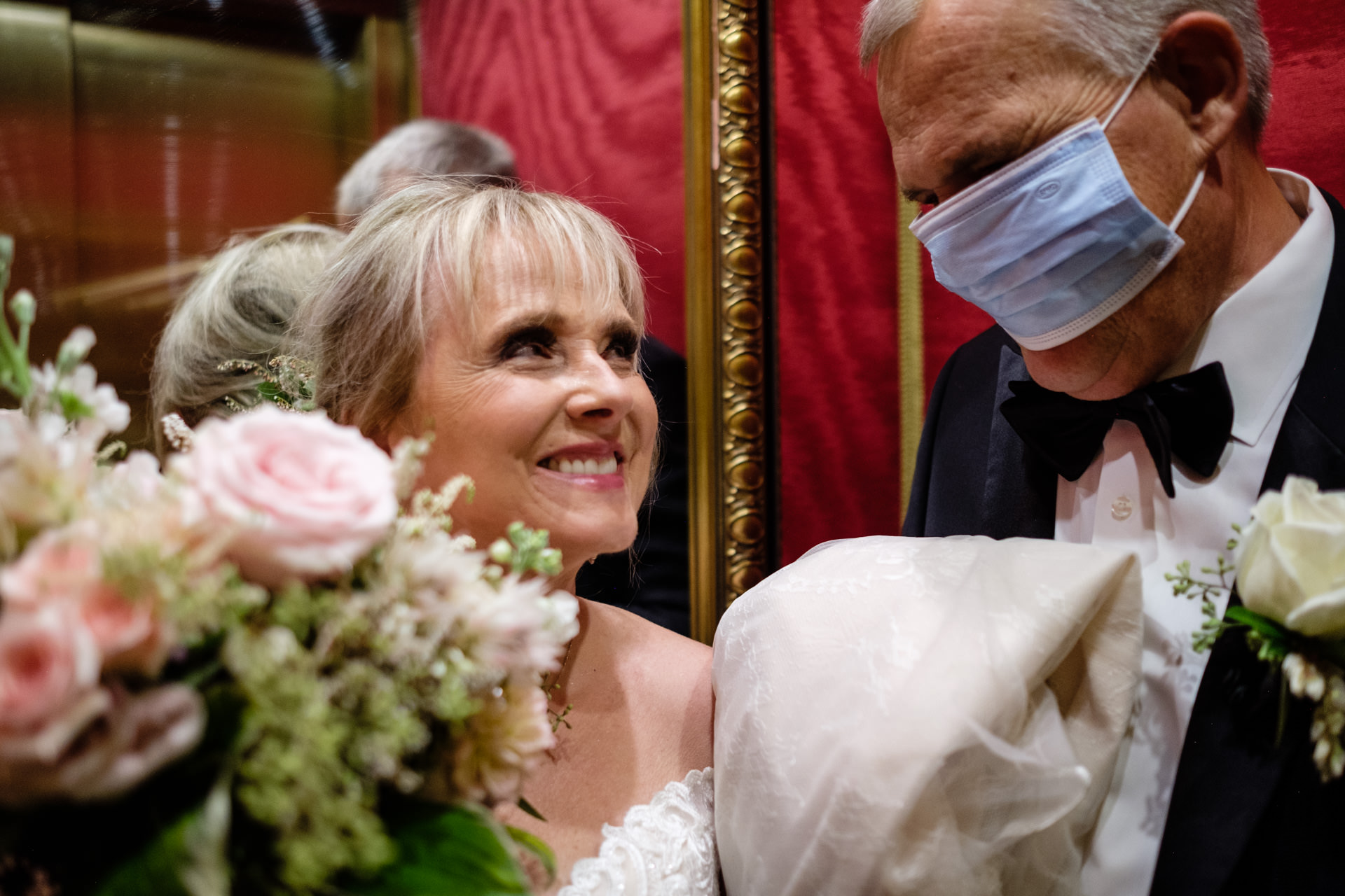 Broadmoor Wedding Venue Photography at Colorado Springs | The bride laughs at how the grooms COVID-19 mask covered his face