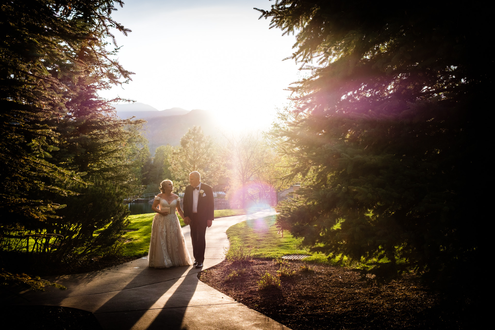 The Broadmoor Wedding Venue of Colorado Springs | The newlyweds walk away from their wedding ceremony
