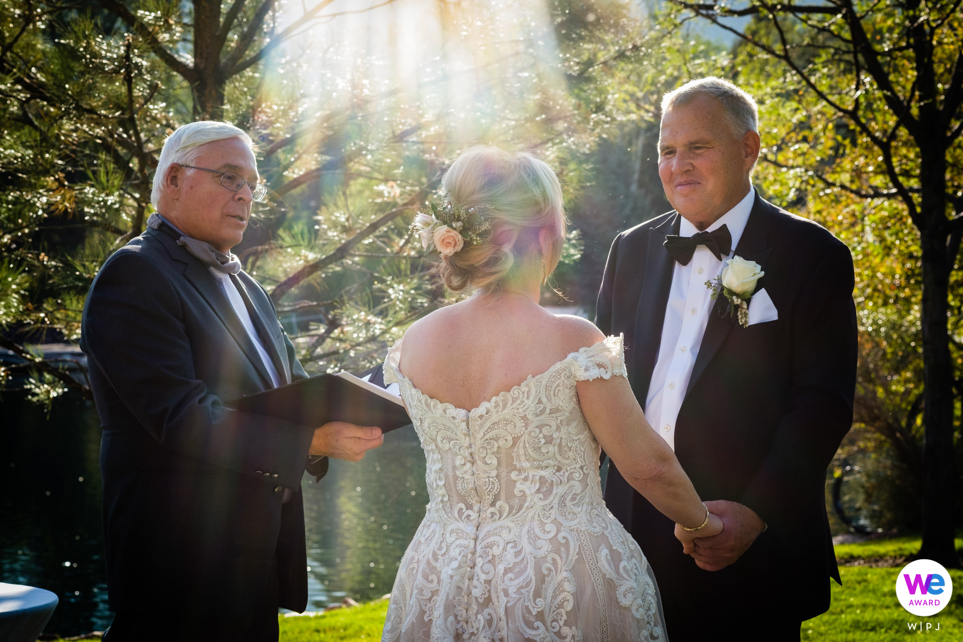 Broadmoor of Colorado Springs - Weddings Photographer | Elopement officiant, Rev. Steve Koeppen, performed the ceremony on the lawn next to the lake