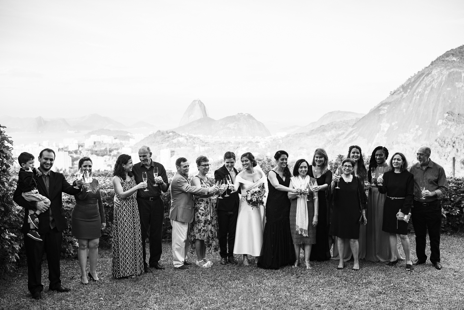 Destination Wedding Image - Casa de Santa Teresa, Rio de Janeiro | All of the wedding guests toast the new couple