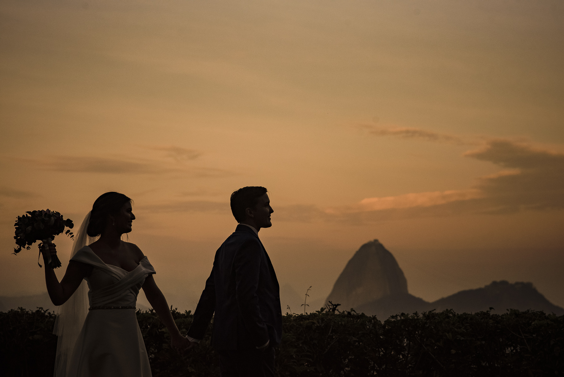 Casa de Santa Teresa, Rio de Janeiro, Brazil Wedding Couple Portrait | The bride and groom walk hand-in-hand