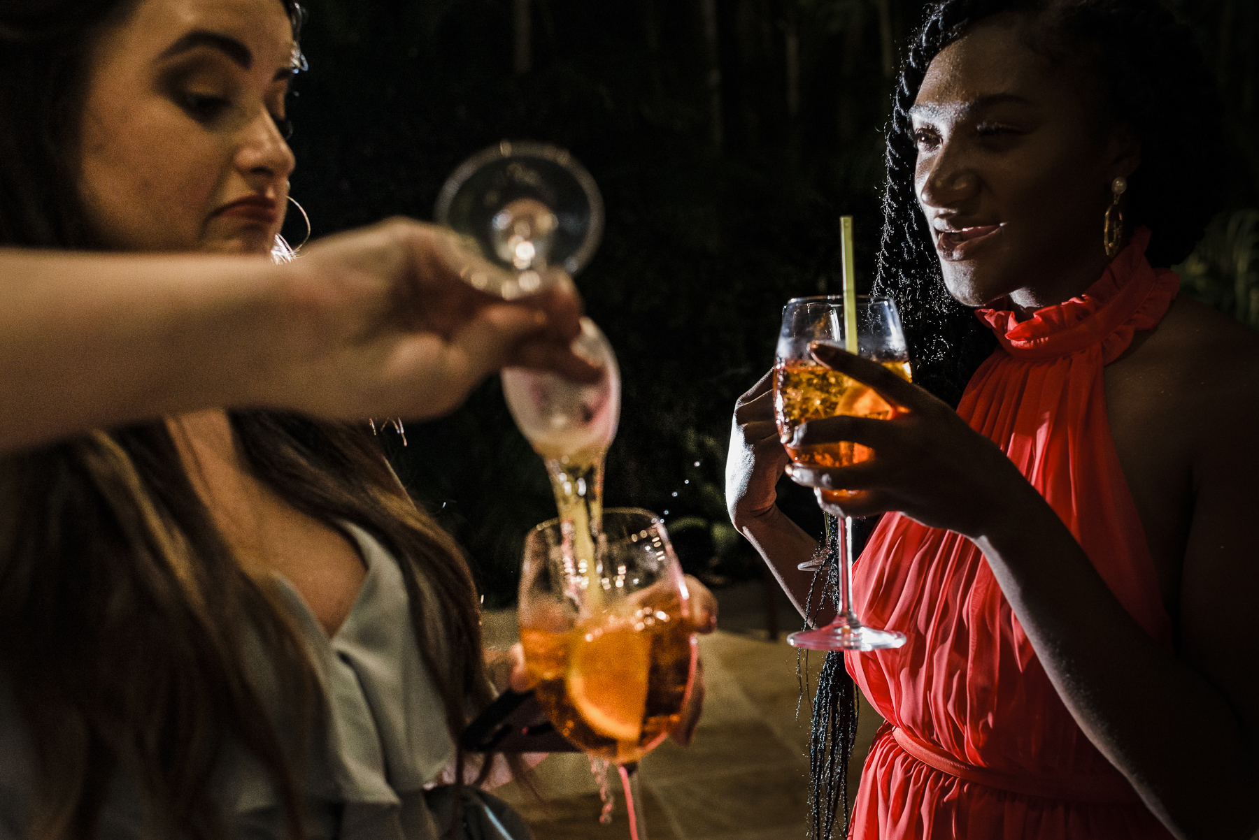 Wedding Reception Venue Image from Casa de Santa Teresa, Brazil | Wedding guests pour drinks as they begin to celebrate