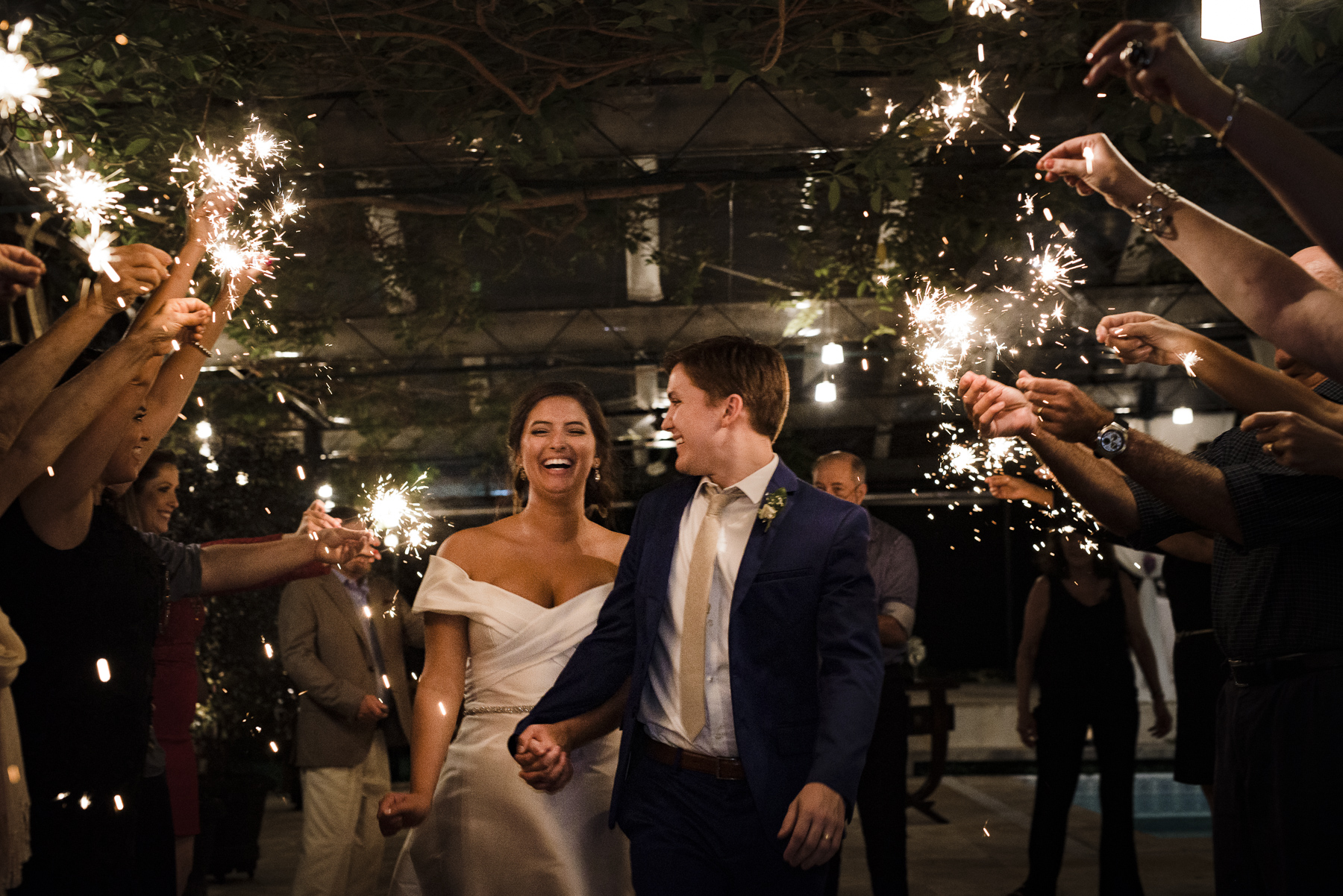 Wedding Venue Photos at Casa de Santa Teresa | The wedding guests use sparklers to light the path