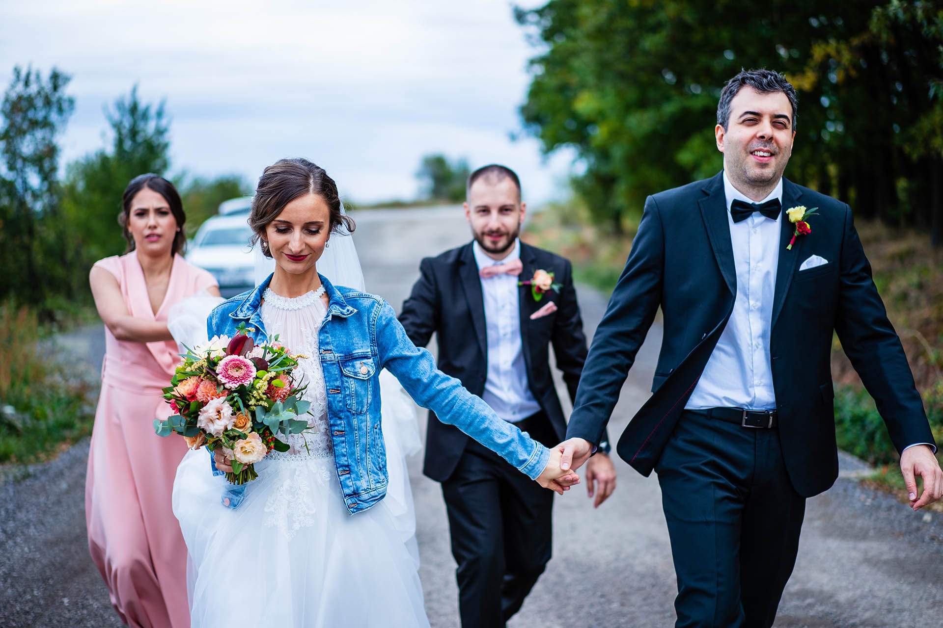 Villa Ekaterina Wedding Couple Image - Vakarel, Bulgaria | The bride and groom walk hand-in-hand down the road