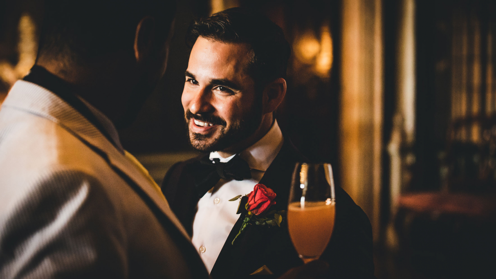 Cà Sagredo Wedding Image in Venice, Italy | The groom greets his wedding party with a smile
