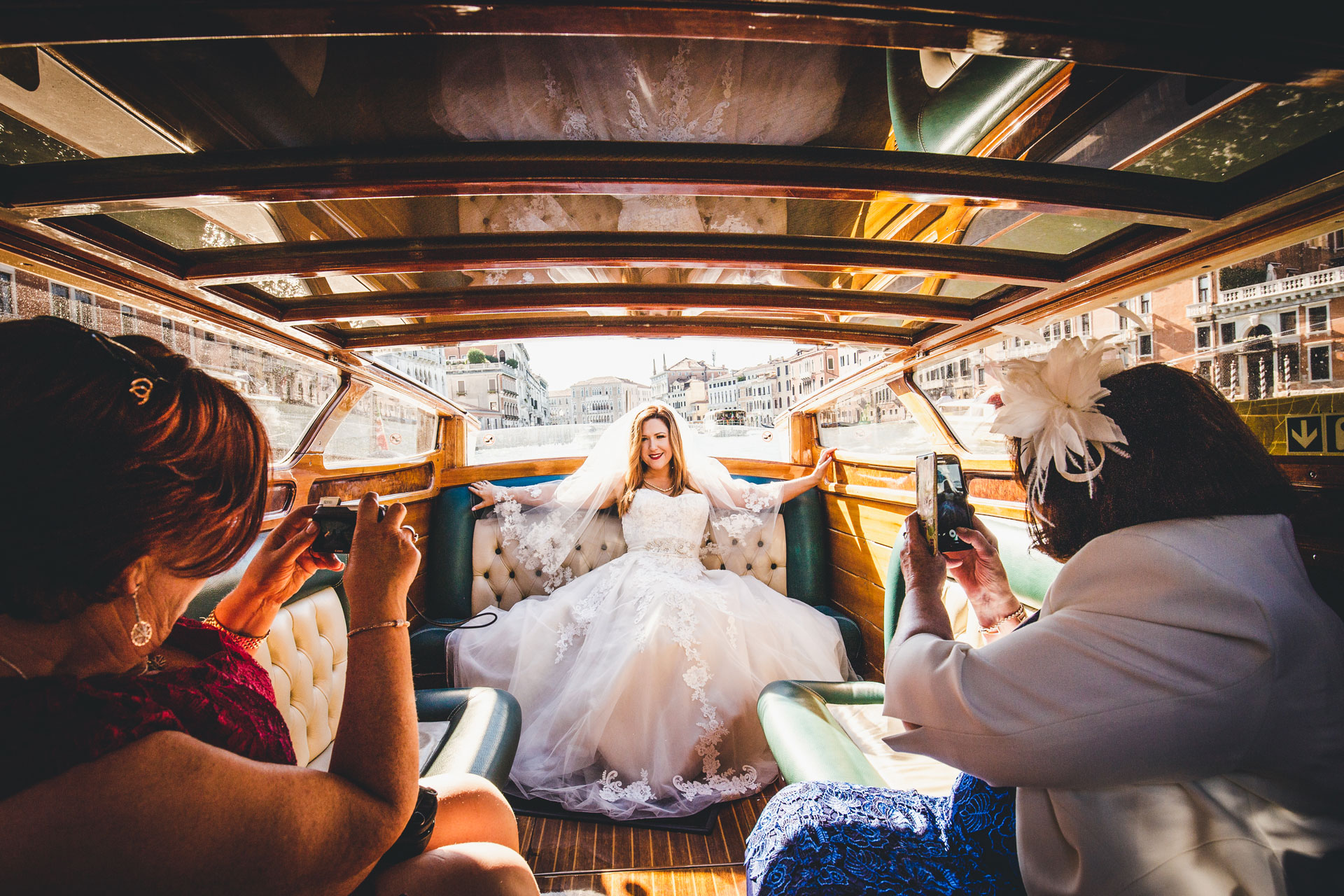 Wedding Reportage Photo from Ca' Sagredo Hotel, Venice | The bride travels on a water taxi
