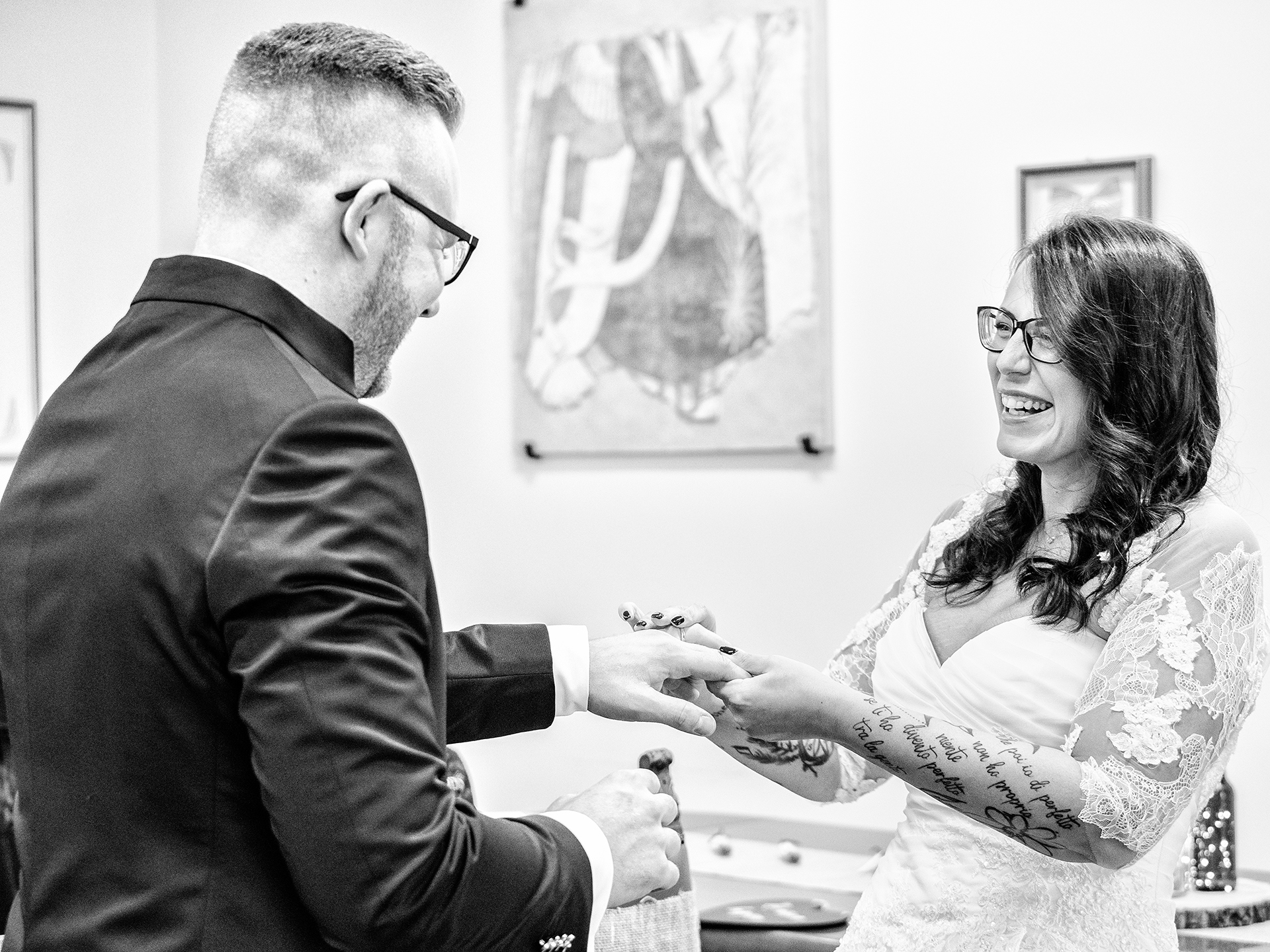 Communal Hall Wedding Photos from Vidigulfo Pavia Italy | The exchange of the rings is only amplified by the happiness in the bride's face