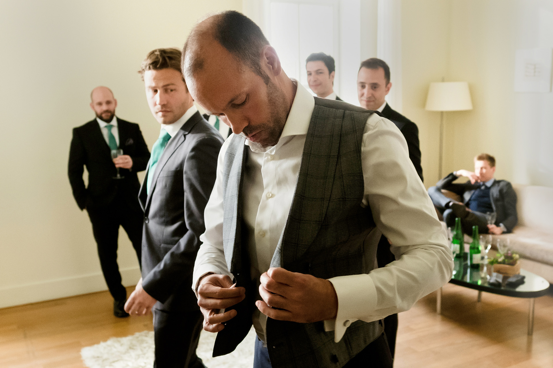 Bosphorus, Istanbul - Ajia Hotel Wedding Photography | The groom is getting dressed in his room where There were 6 groomsmen