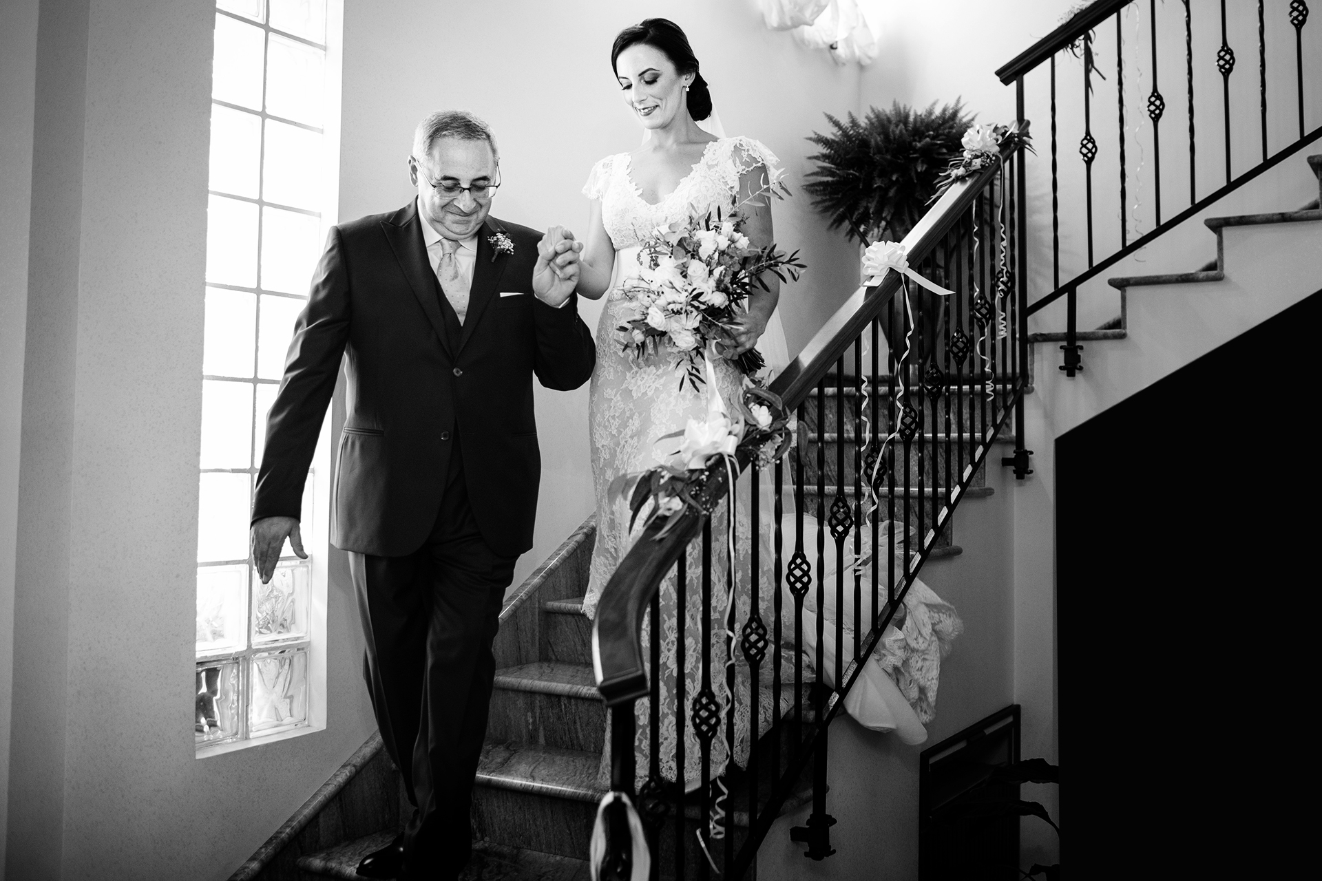 Sicily Wedding Photographers of Italy | Accompanied by her father, the elegant bride walks down the stairs