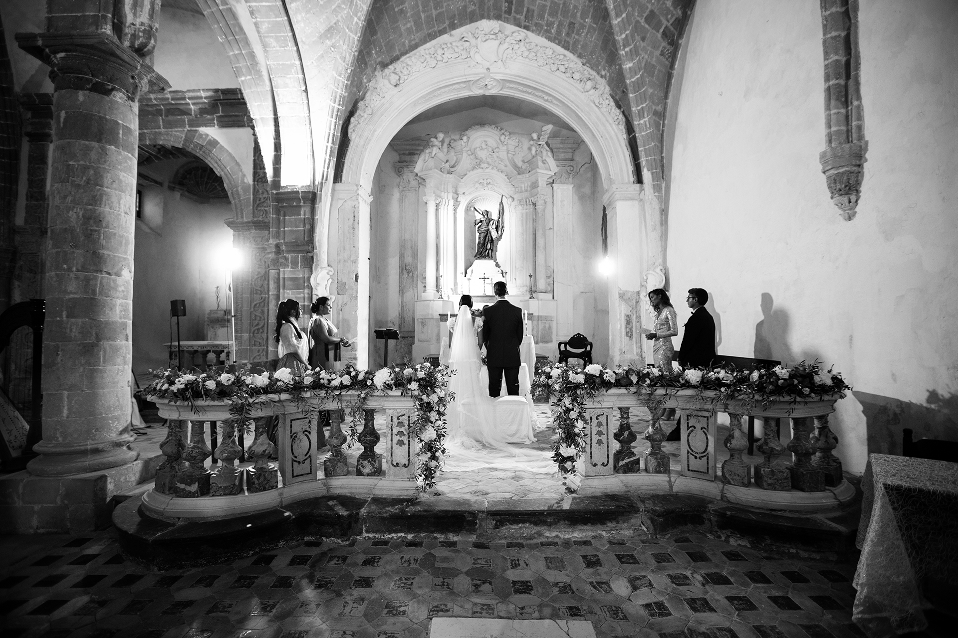 Sicily and Italy Wedding Photographers | The couple takes their vows in a historic Church