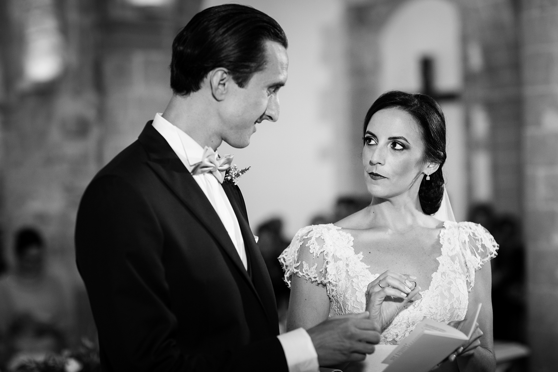 Sant'Orsola Church - Mount Erice, Sicily Wedding Image | With a determined gaze, the bride places the wedding ring on his finger