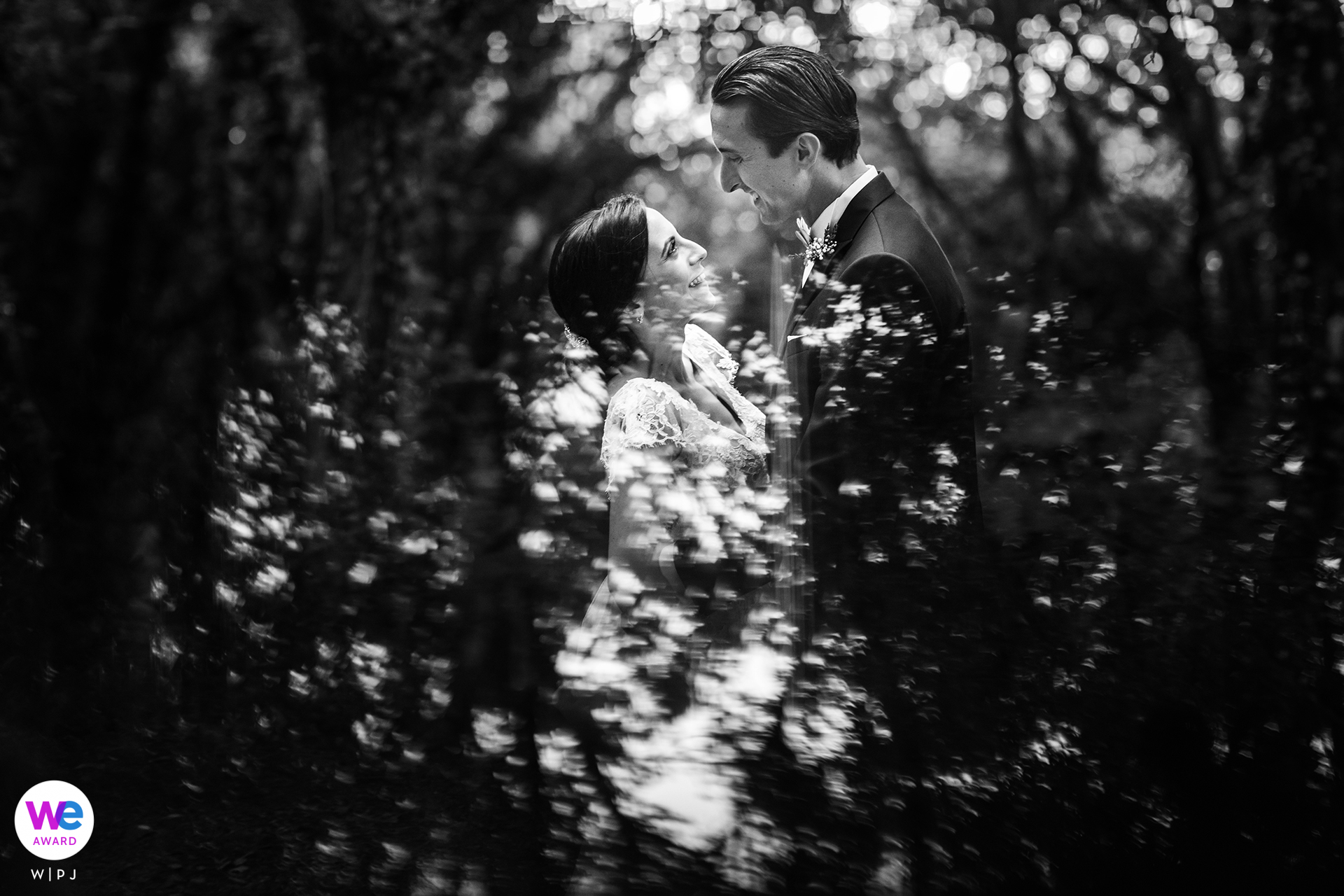 Sicily Wedding Photographers | the bride and groom embrace in the town of Erice in Italy