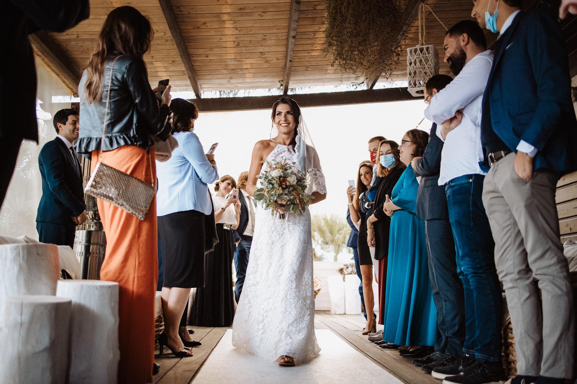 Fiumara Beach Grosseto, Italy Wedding Photos | The bride walks down the aisle with confidence