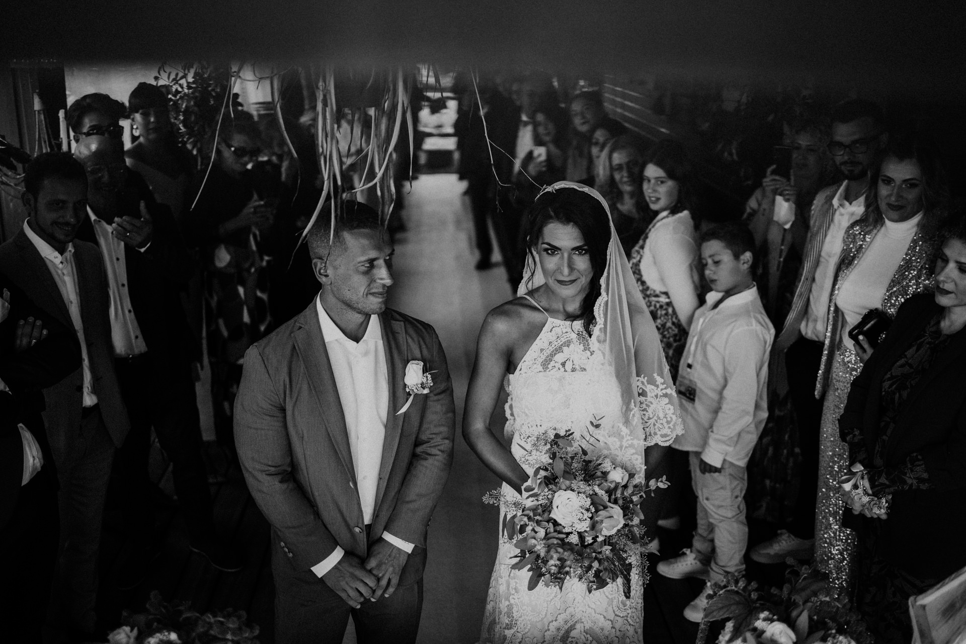 Fiumara Beach Wedding Photography - Grosseto, Italy | The bride and groom look both determined and excited