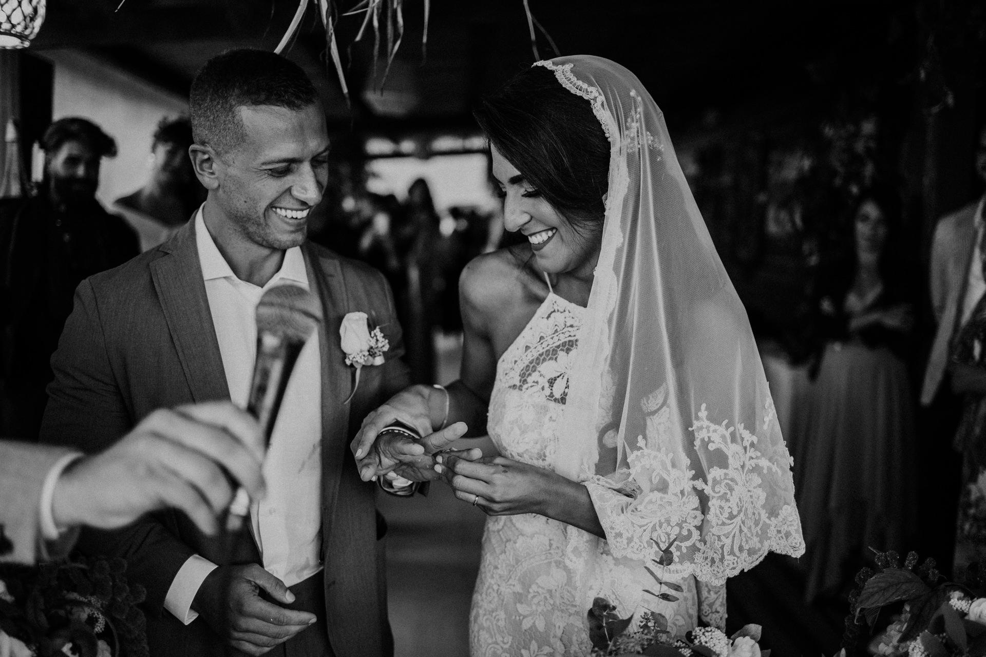 Fiumara Beach - Grosseto, Italy Wedding Photographer | The couple laughs with delight