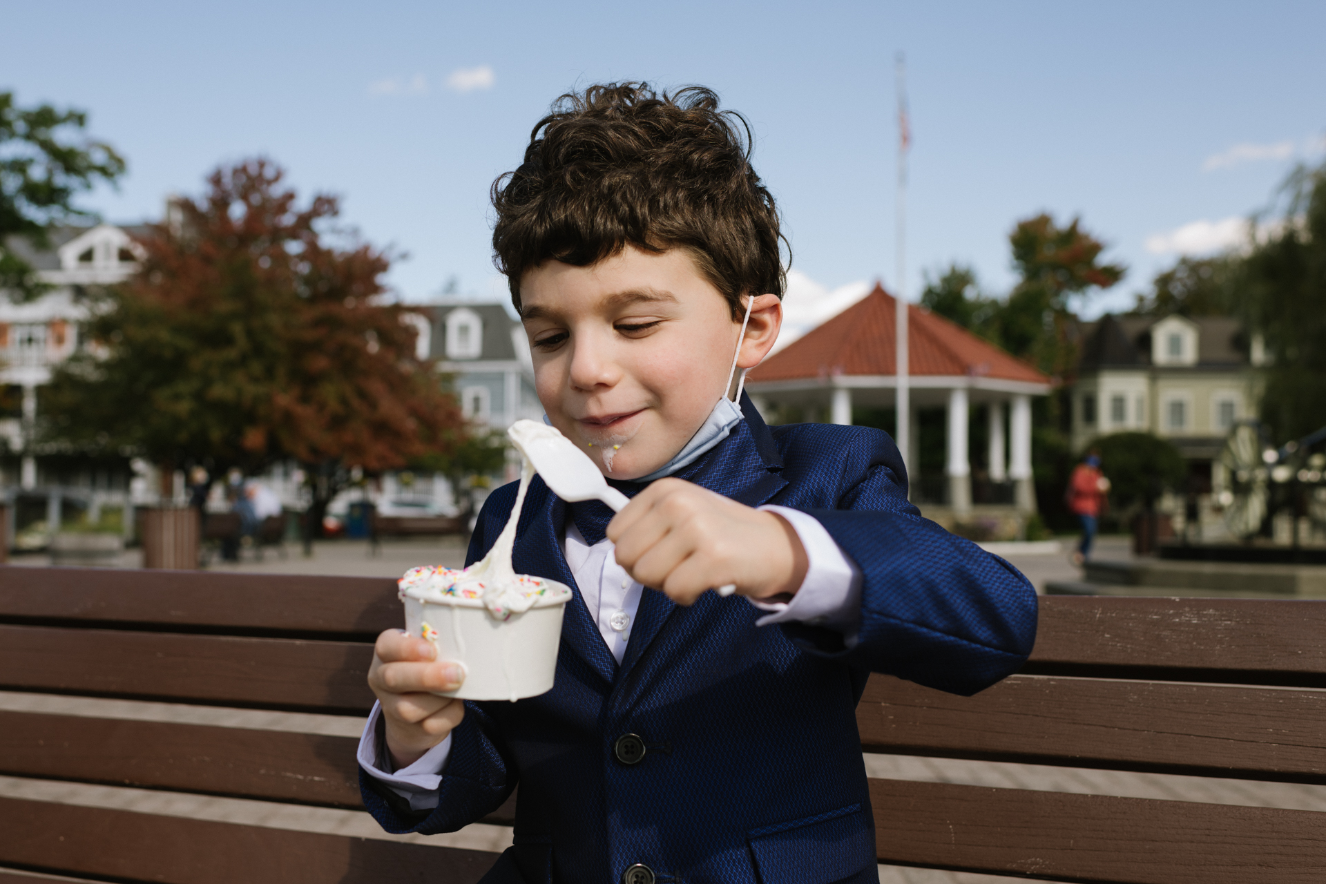 NY Wedding Ceremony Photo from Dockside Park, Cold Spring | A little boy smiles as he digs into his cup of ice cream