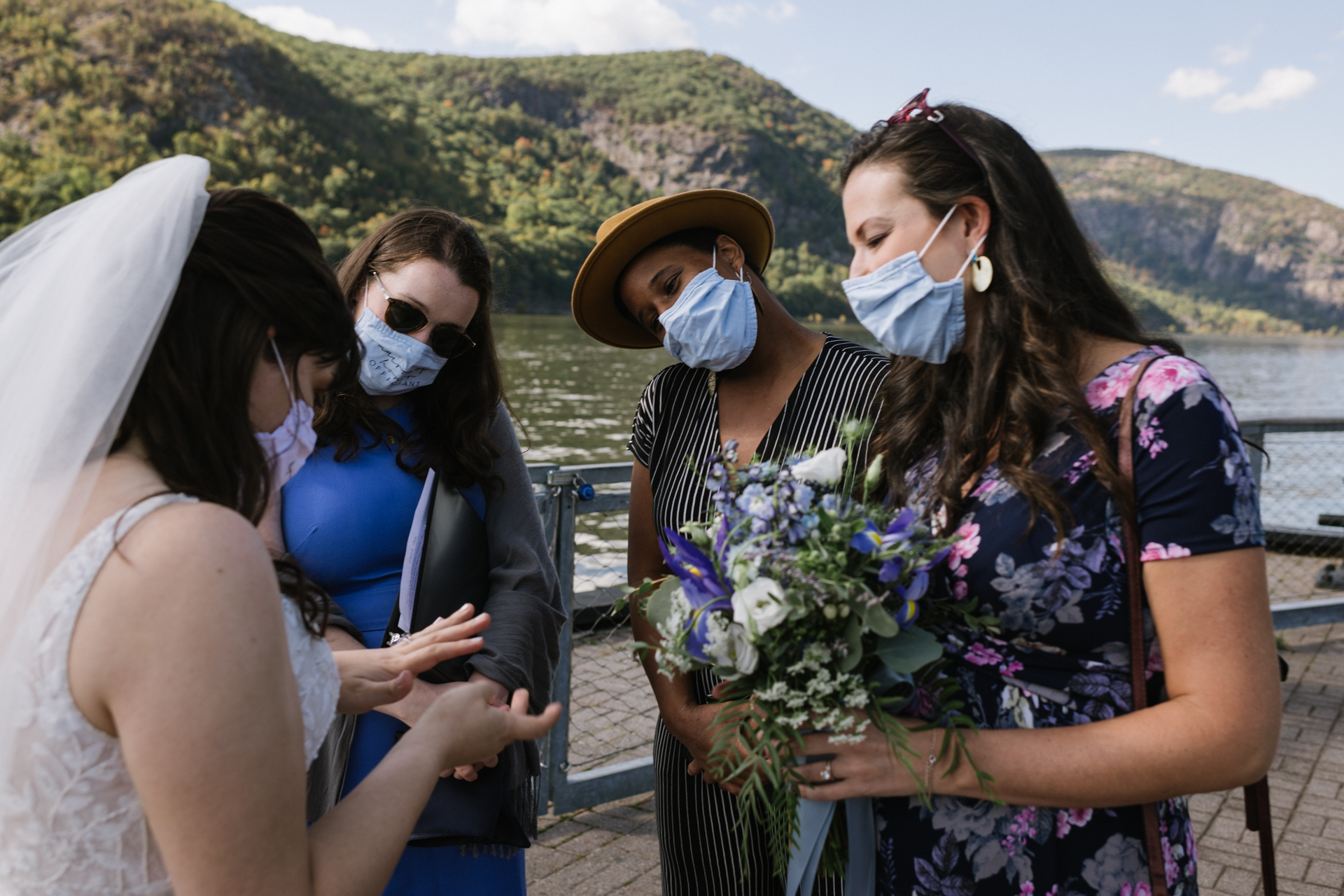 NY Wedding Photography from Dockside Park, Cold Spring | The bride shows her new wedding ring to friends