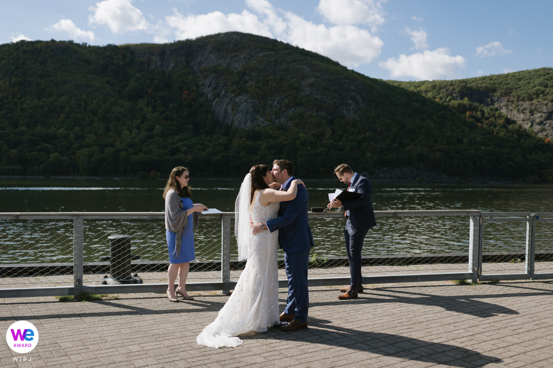 Dockside Park, Cold Spring, New York Wedding Photography | The couple embrace and kiss at the end of their wedding ceremony