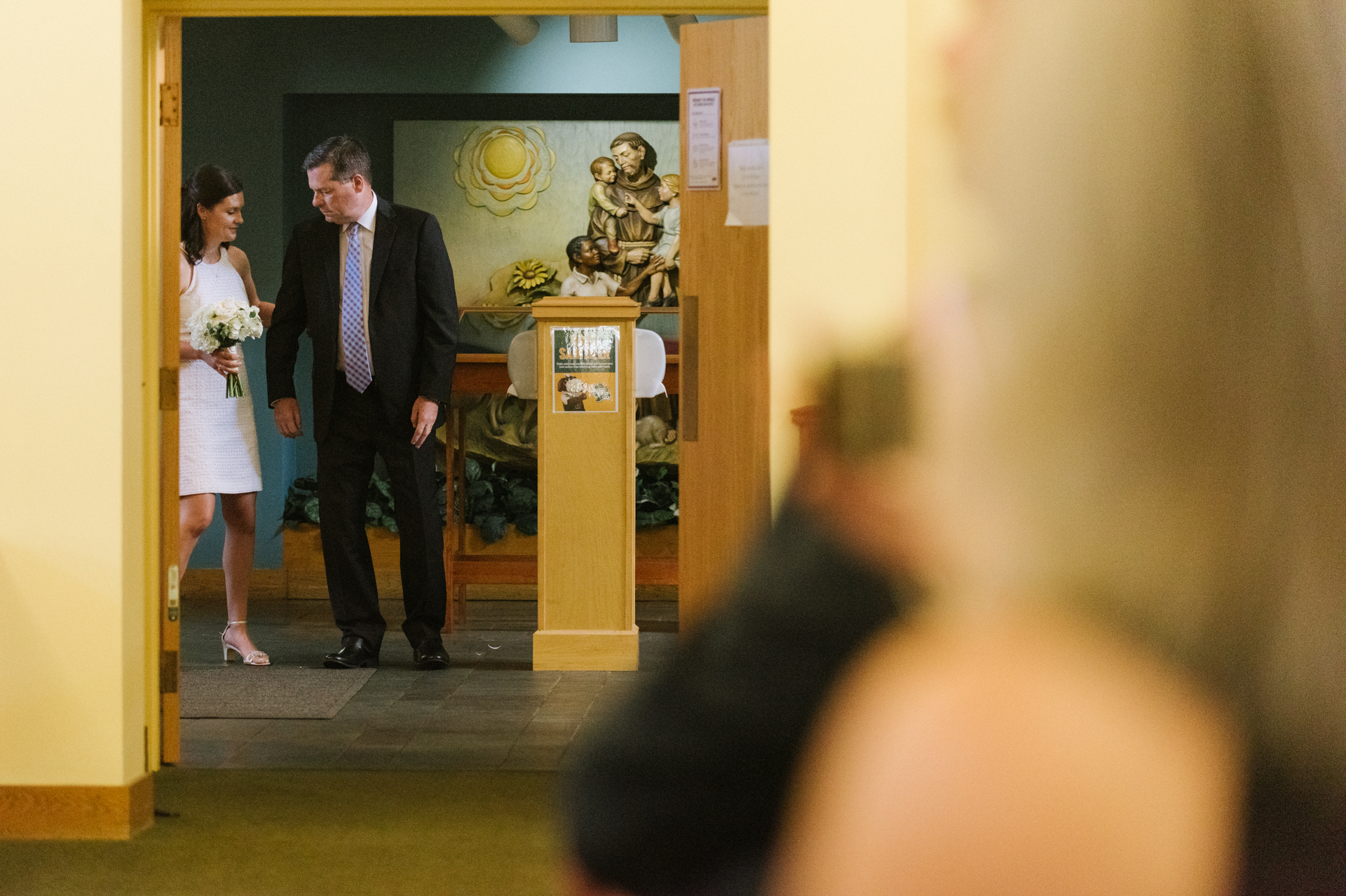 St. Mary of the Angels Chapel, Siena College Wedding Image | A bride takes her father's arm as they prepare to walk down the aisle