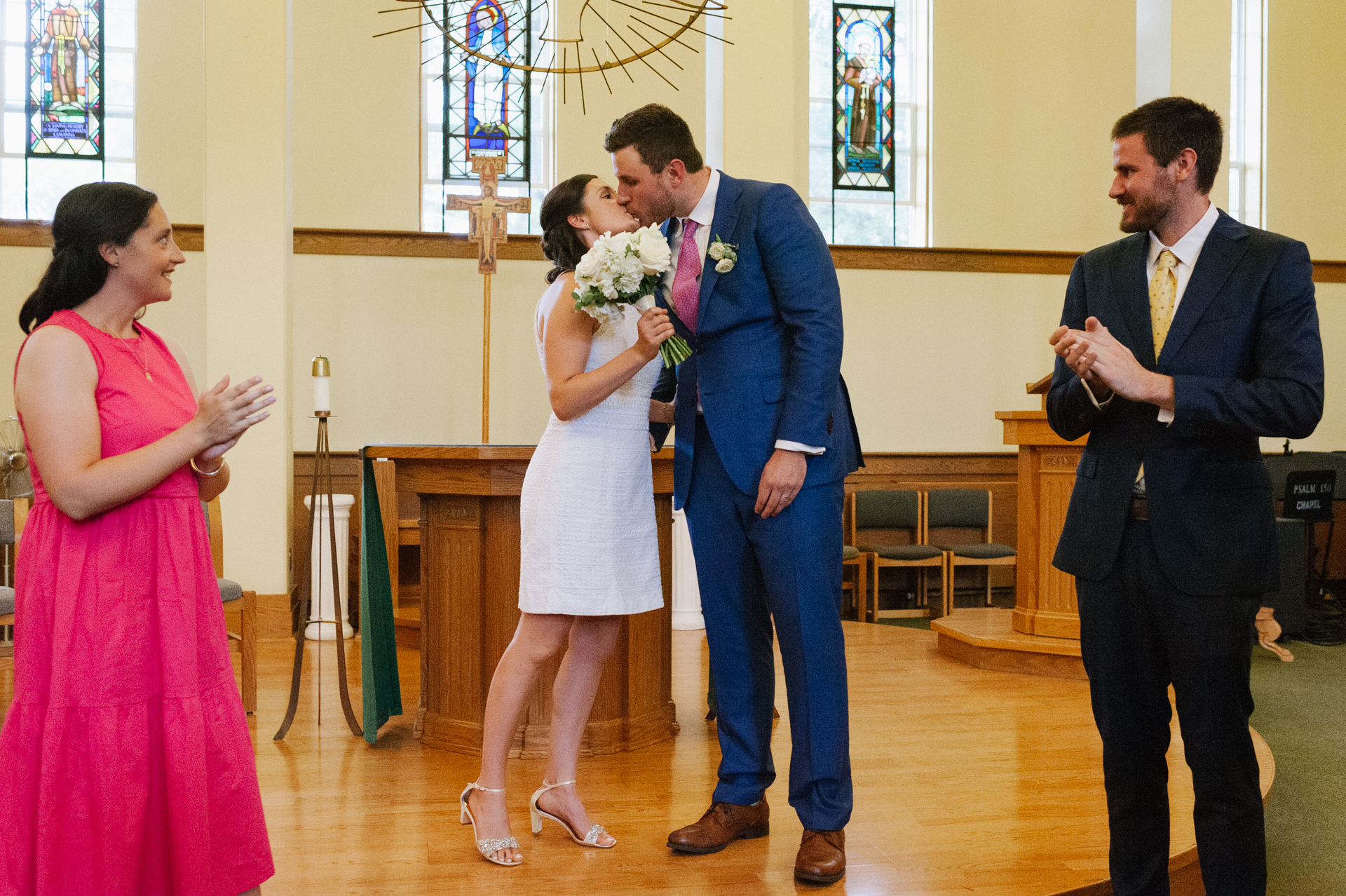 St. Mary Angels Chapel, New York Wedding Photos | The newlyweds kiss at the end of their wedding ceremony