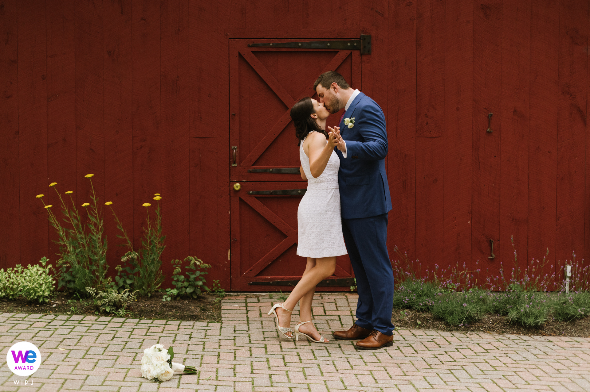 Pruyn House Wedding Day Portrait, NY | The bride and groom pose for a portrait with flowers by the side and a wedding bouquet on the ground in front of them