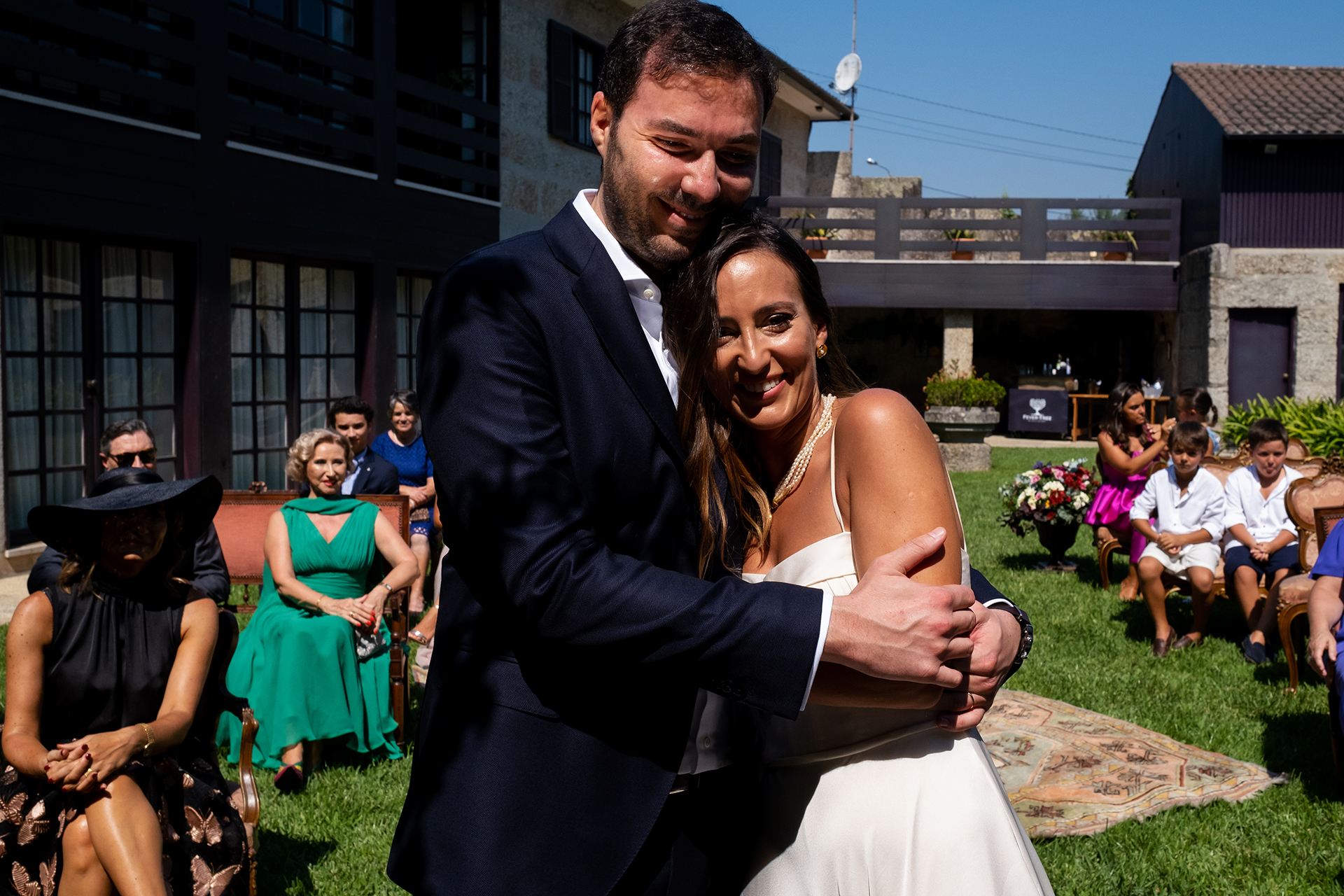 Wedding Photography of Portugal | The bride and groom share a playful hug after they exchange their rings