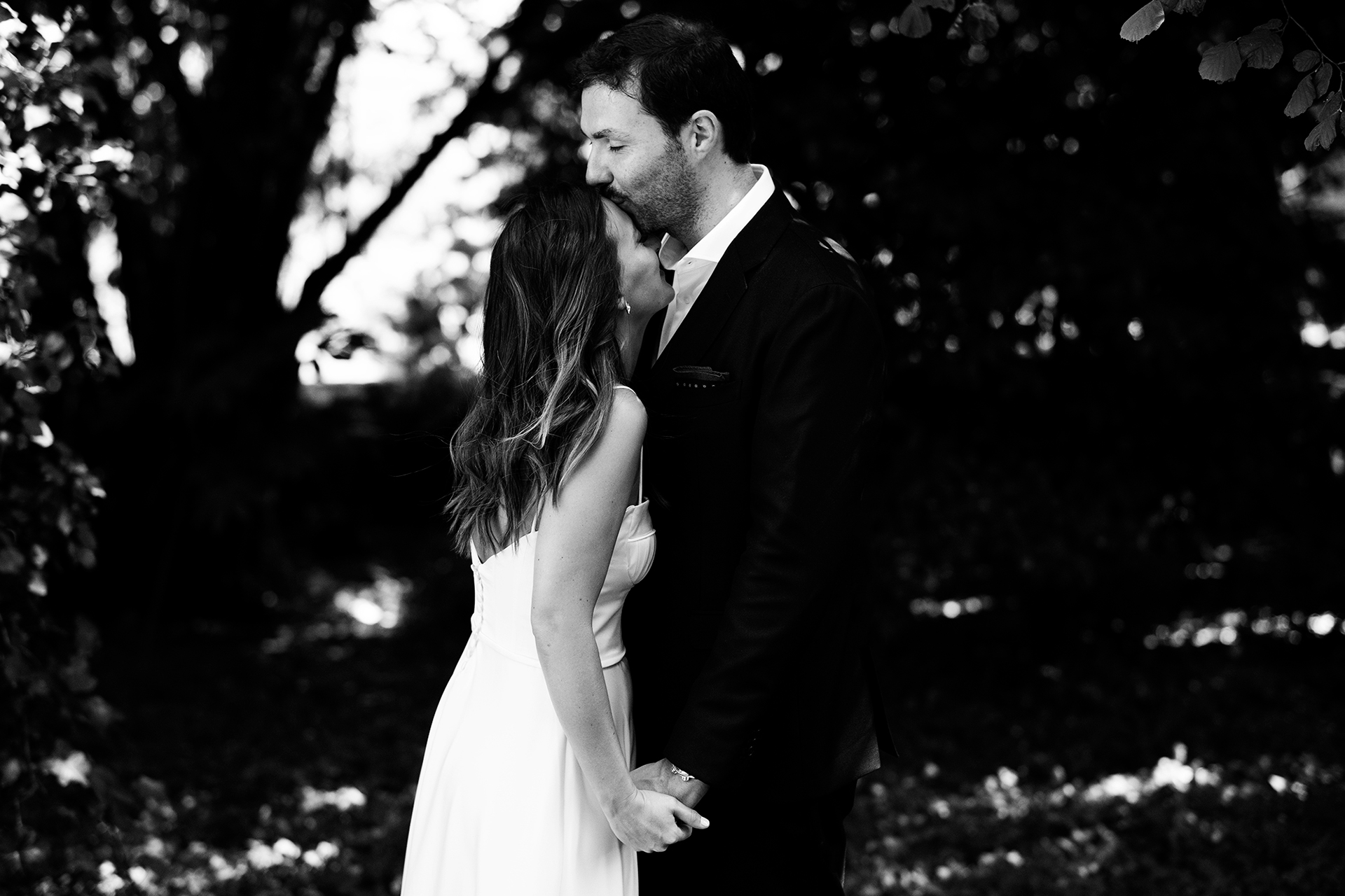 Backyard Wedding Image - Portugal Elopements | The groom spontaneously kisses the bride on the forehead