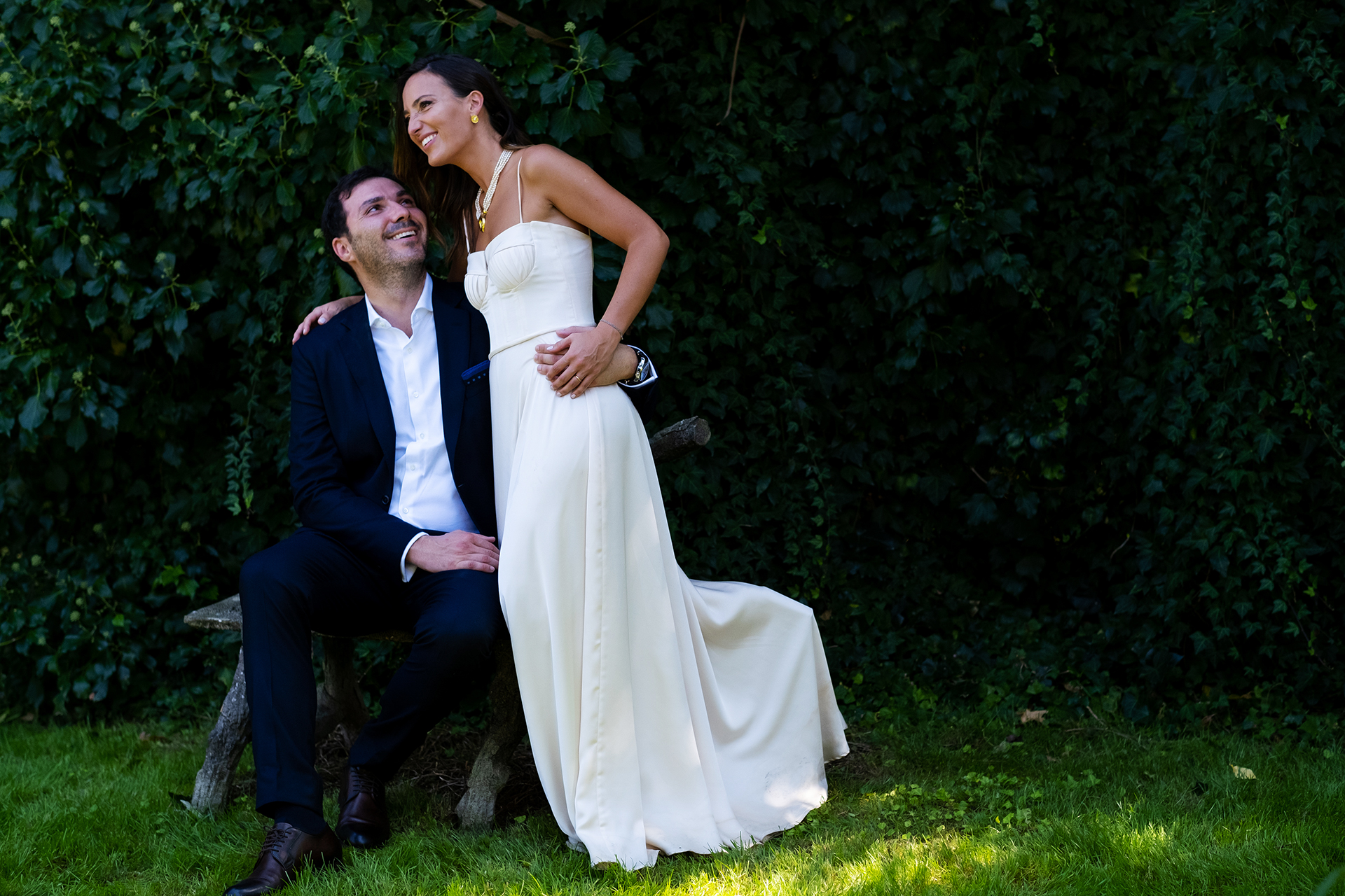 Guimaraes Backyard Wedding Portrait | The groom looks at his bride with adoration and pride