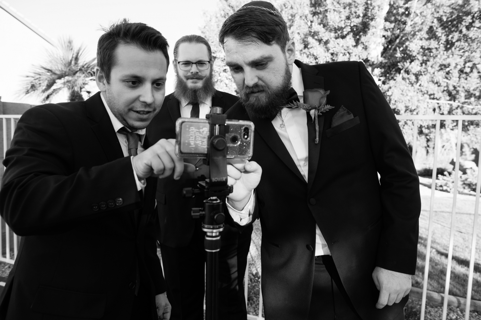 Wedding Photographers for Phoenix, AZ | The groom and his friends configure a phone in order to broadcast the wedding ceremony
