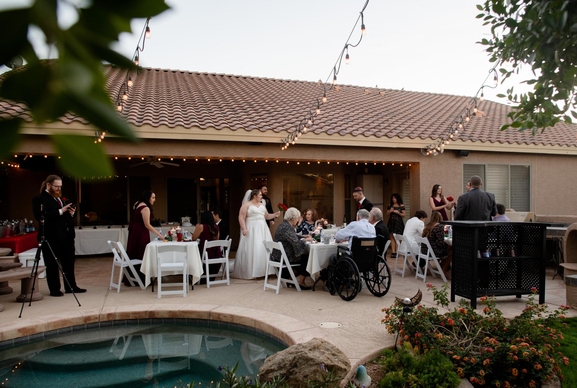 Phoenix Arizona, Poolside Backyard Wedding Picture | The couple spent time transforming their relative's backyard into a romantic and idyllic wedding reception venue