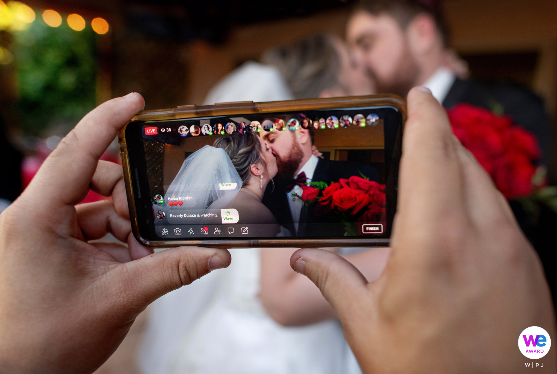 Intimate Backyard Wedding Photography in Phoenix, Arizona | A wedding guest broadcasts the newlyweds' first kiss on Facebook Live