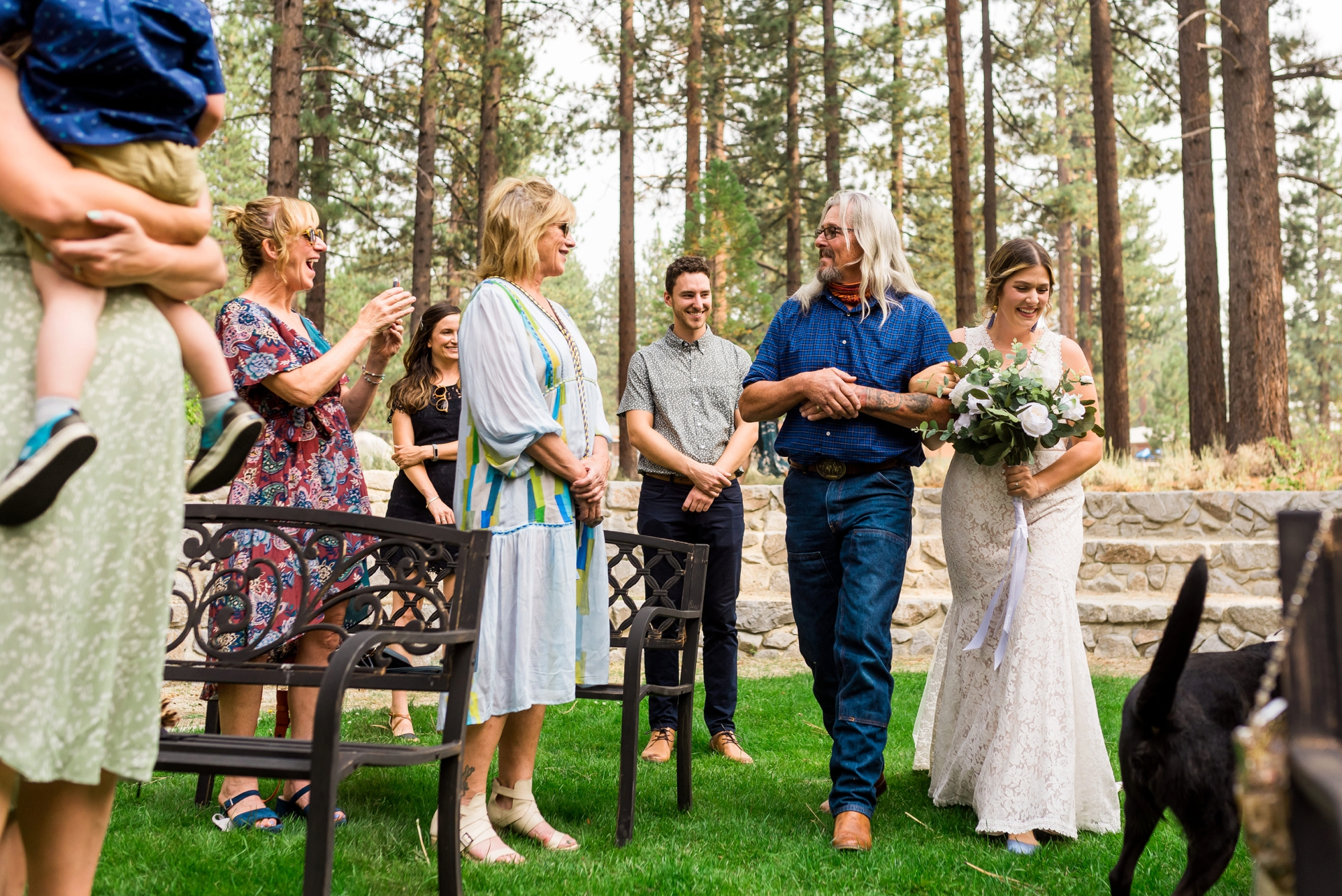 Weddings at Demonstration Garden of Lake Tahoe Community College | The bride and her father proceed down the outdoor aisle